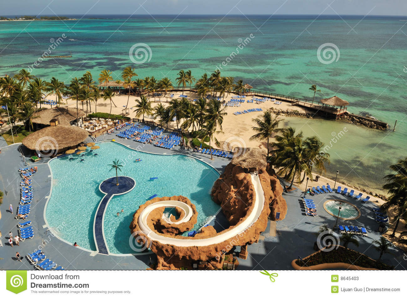 resort with swimming pool by caribbean ocean stock photos. Black Bedroom Furniture Sets. Home Design Ideas