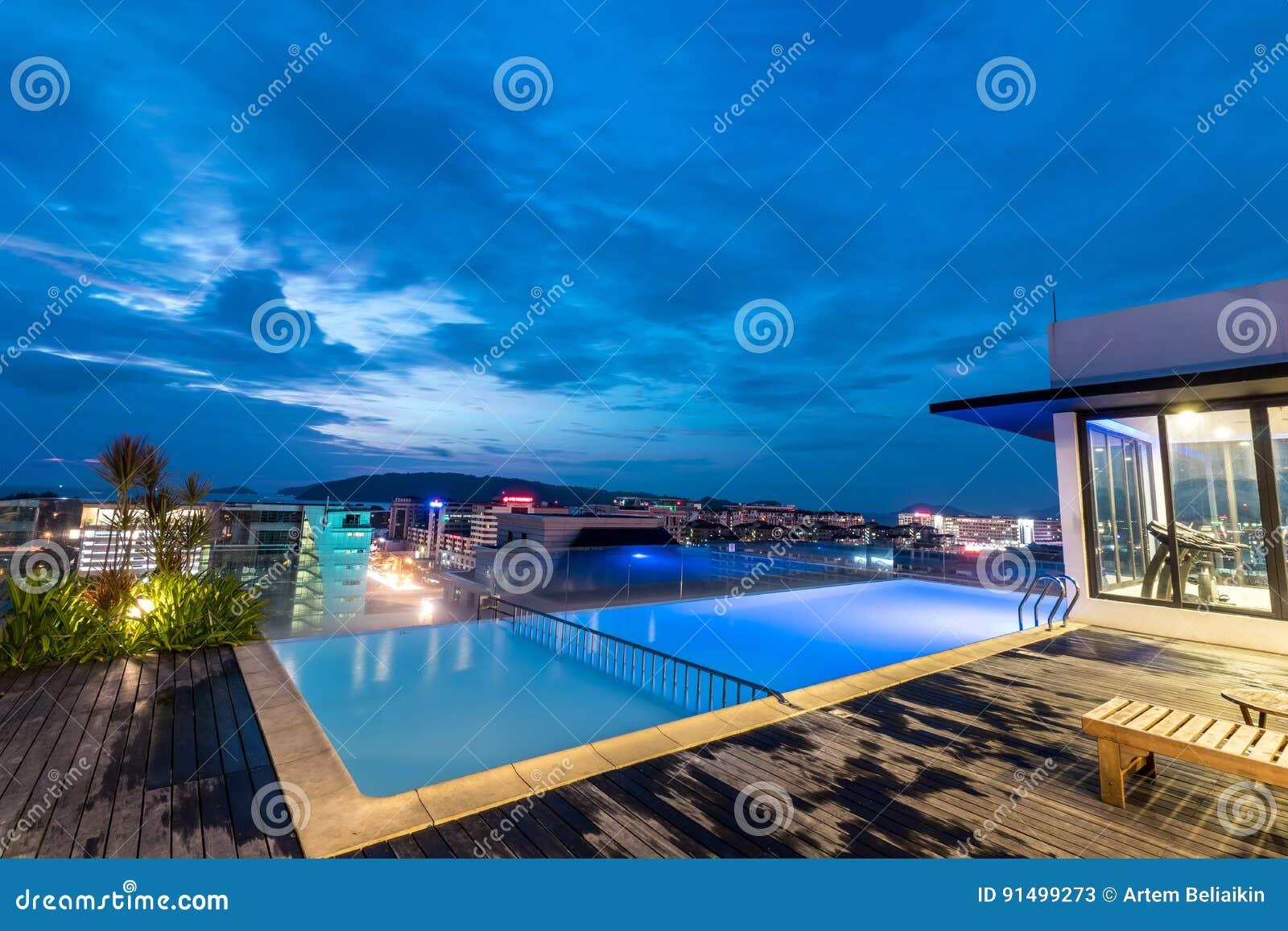 A resort swimming pool on the roof at night. Kota Kinabalu city, Malaysia.