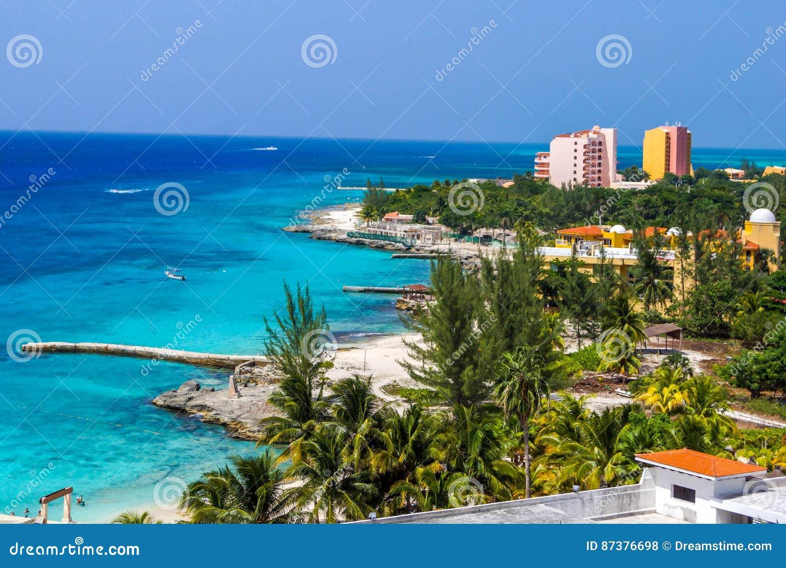 Resorts dot shoreline on Caribbean island