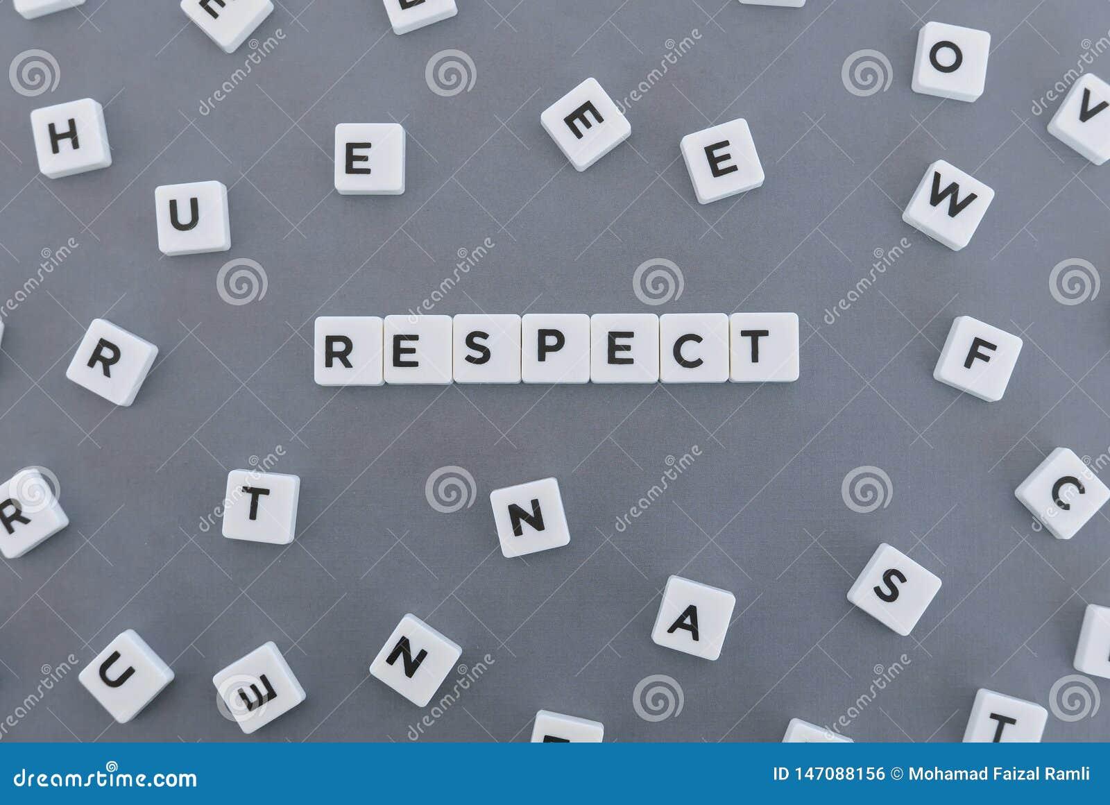 Respektord som g?ras av fyrkantigt bokstavsord p? gr? bakgrund