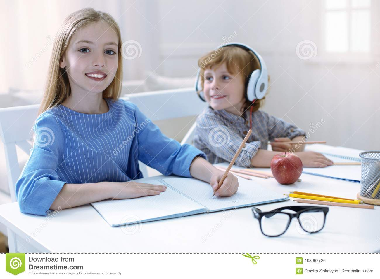 Responsible Brother And Sister Doing Their Homework Stock Photo