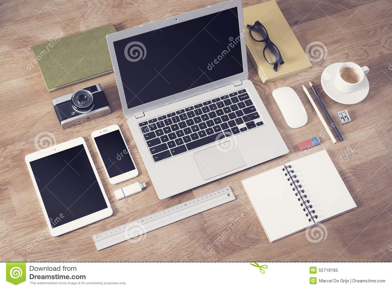 responsive design mockup with different office items on table top