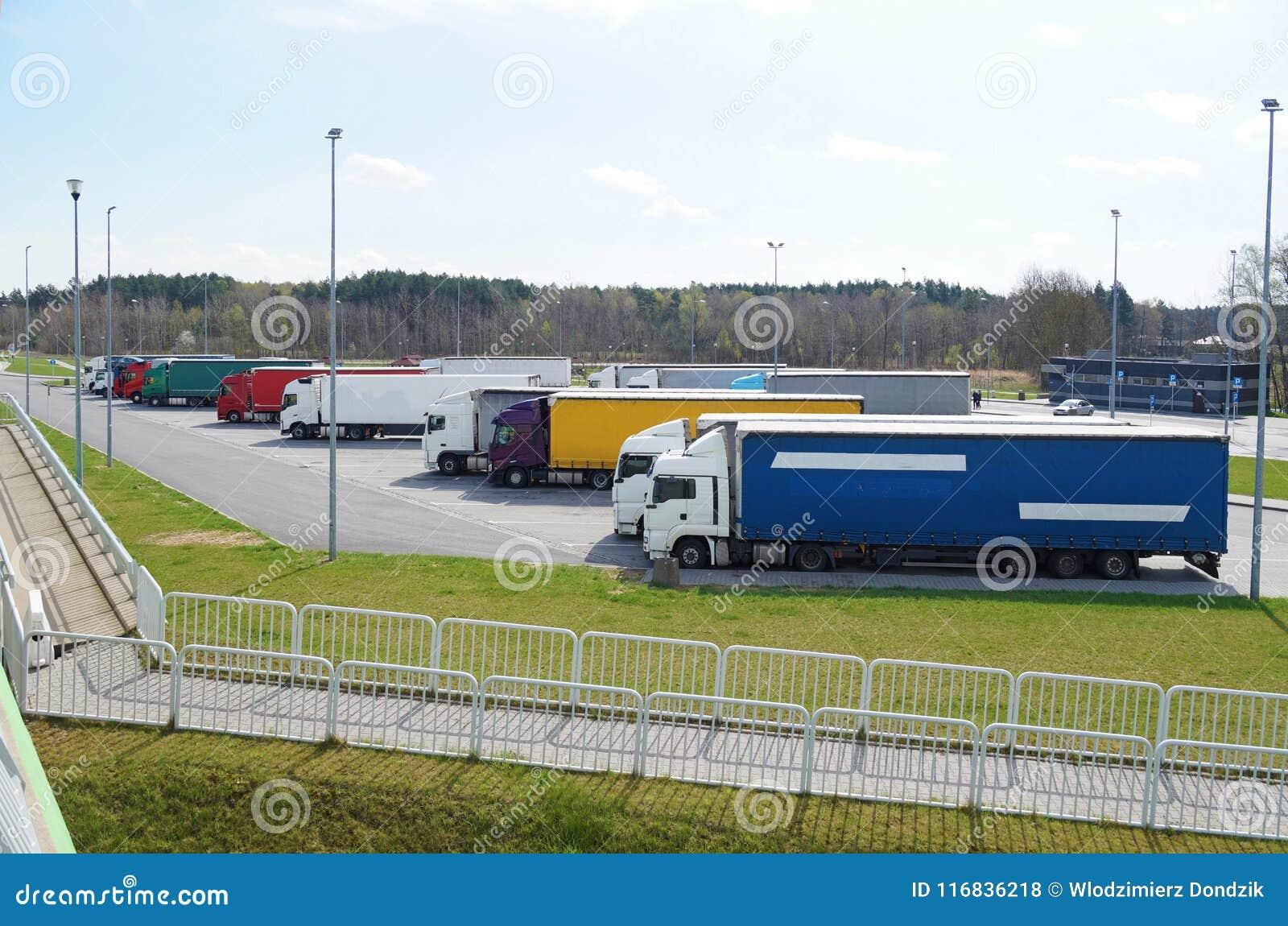 Weekend break in drivers` work. Rest area filled with lorries.