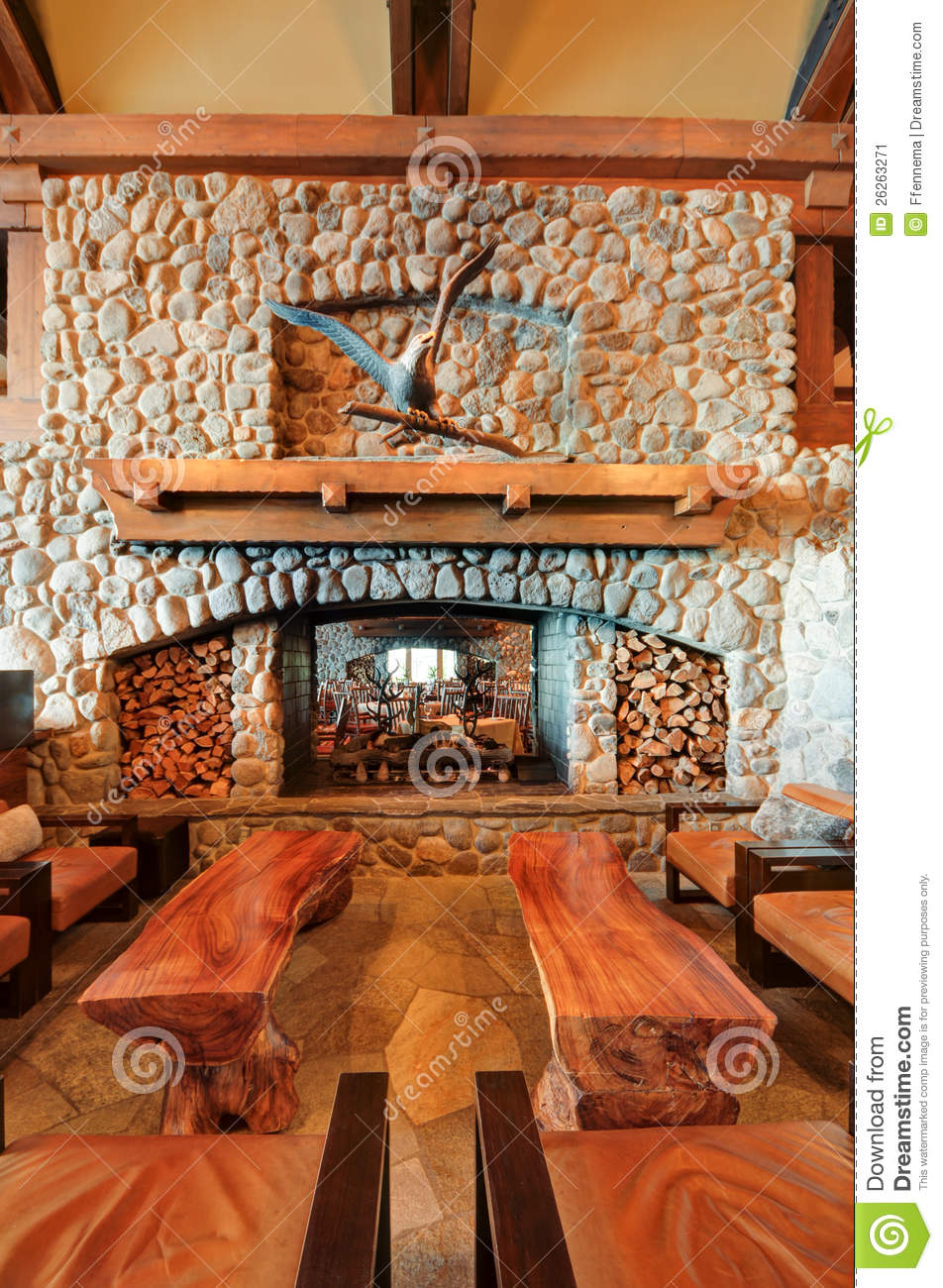 Restaurant Bar Fireplace With Wooden Benches Stock Image