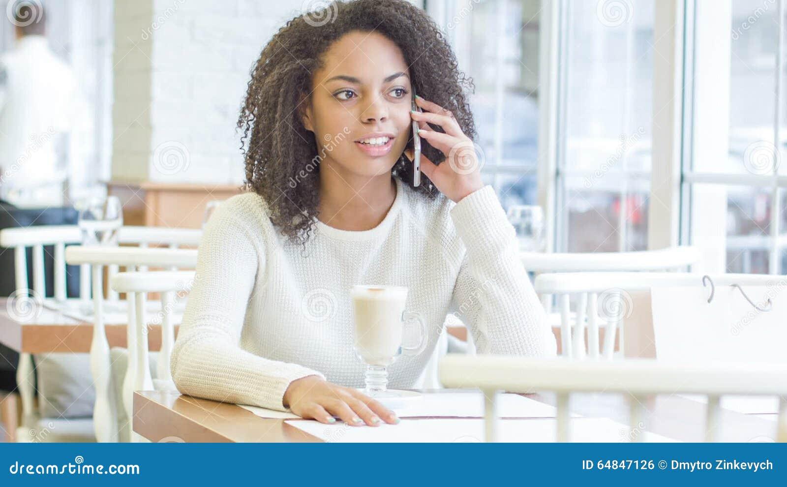 Restaurant customer having a phone talk