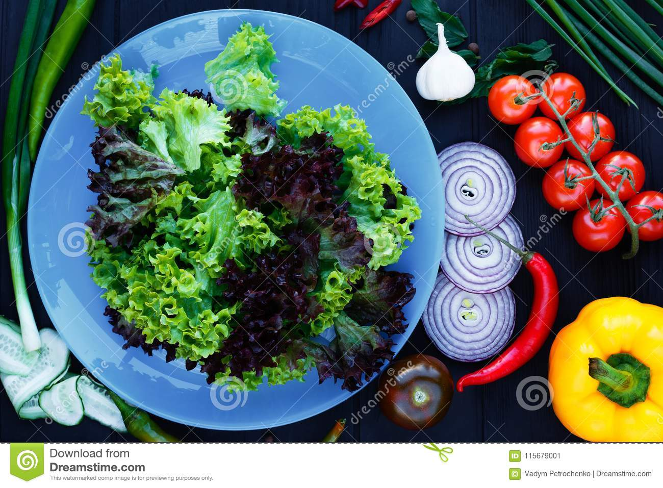 Lettuce Salad On Blue Plate, Decorated With Various Tomatoes