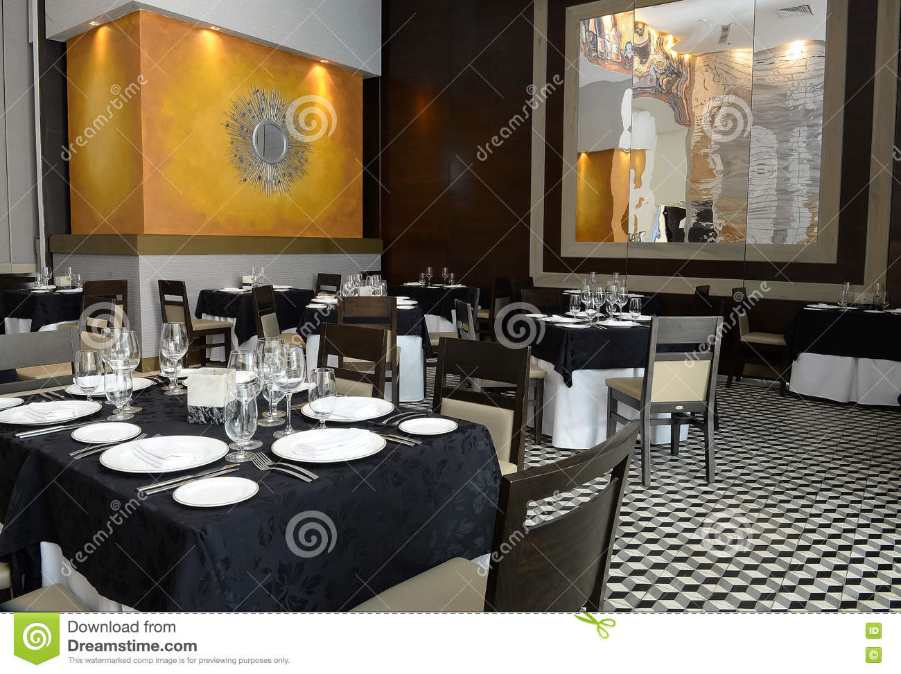 Interior Of Empty Modern Restaurant With Black And White Table Clothes Checkered Tile Flooring