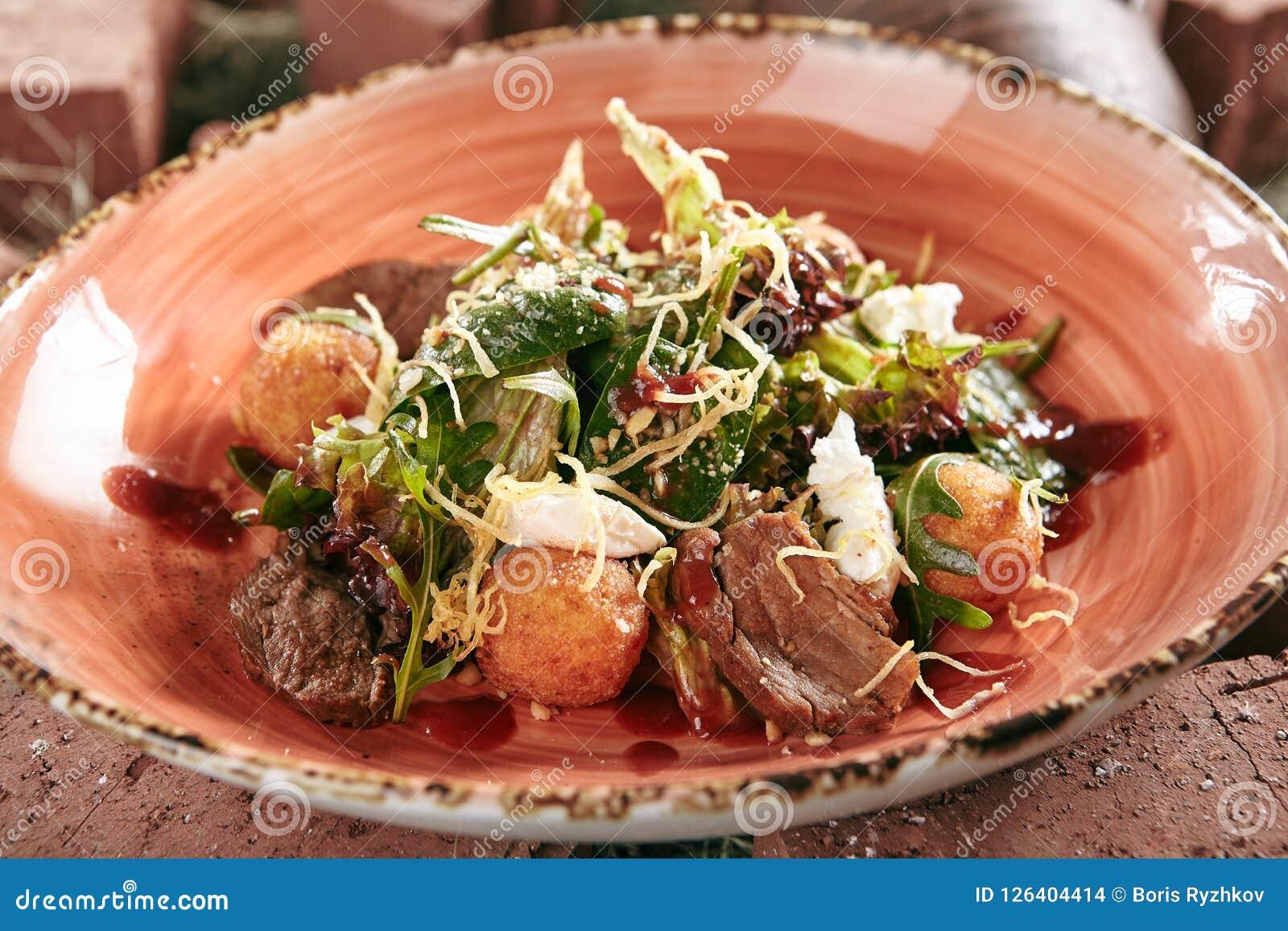 Duck Breast Salad with Crispy Potato Balls on Rustic Style Hay B