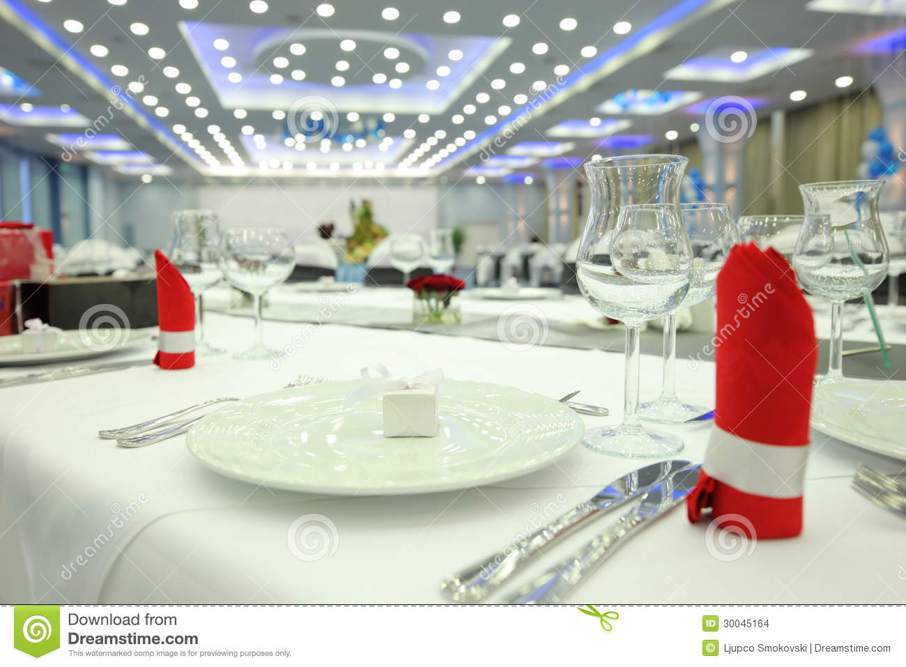 Restaurant table with plate wine glass and cutlery stock