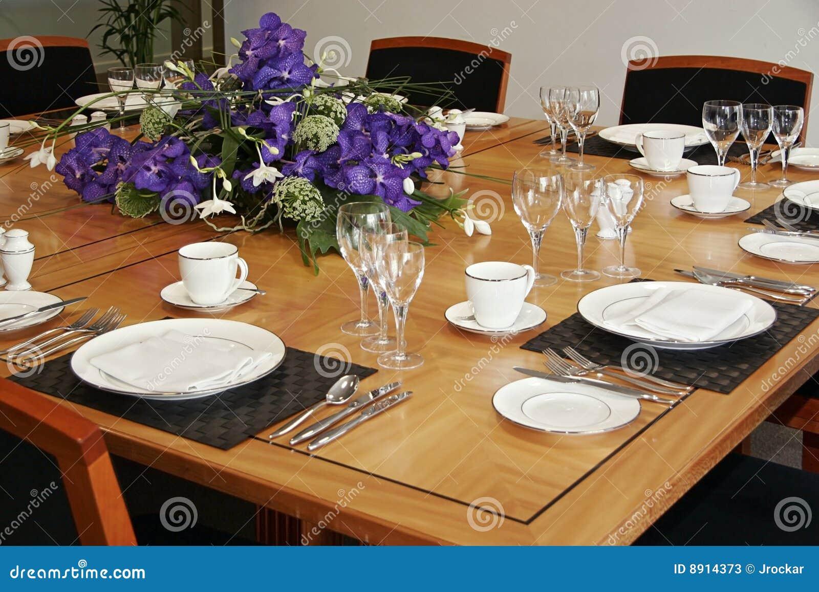 Restaurant Table Setup With Cut Flowers Stock Photos