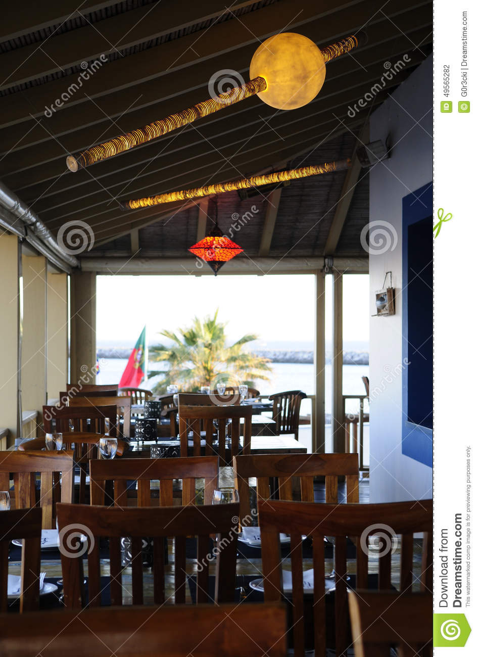 Restaurant terrace with wooden tables and chairs stock for Restaurant with terrace