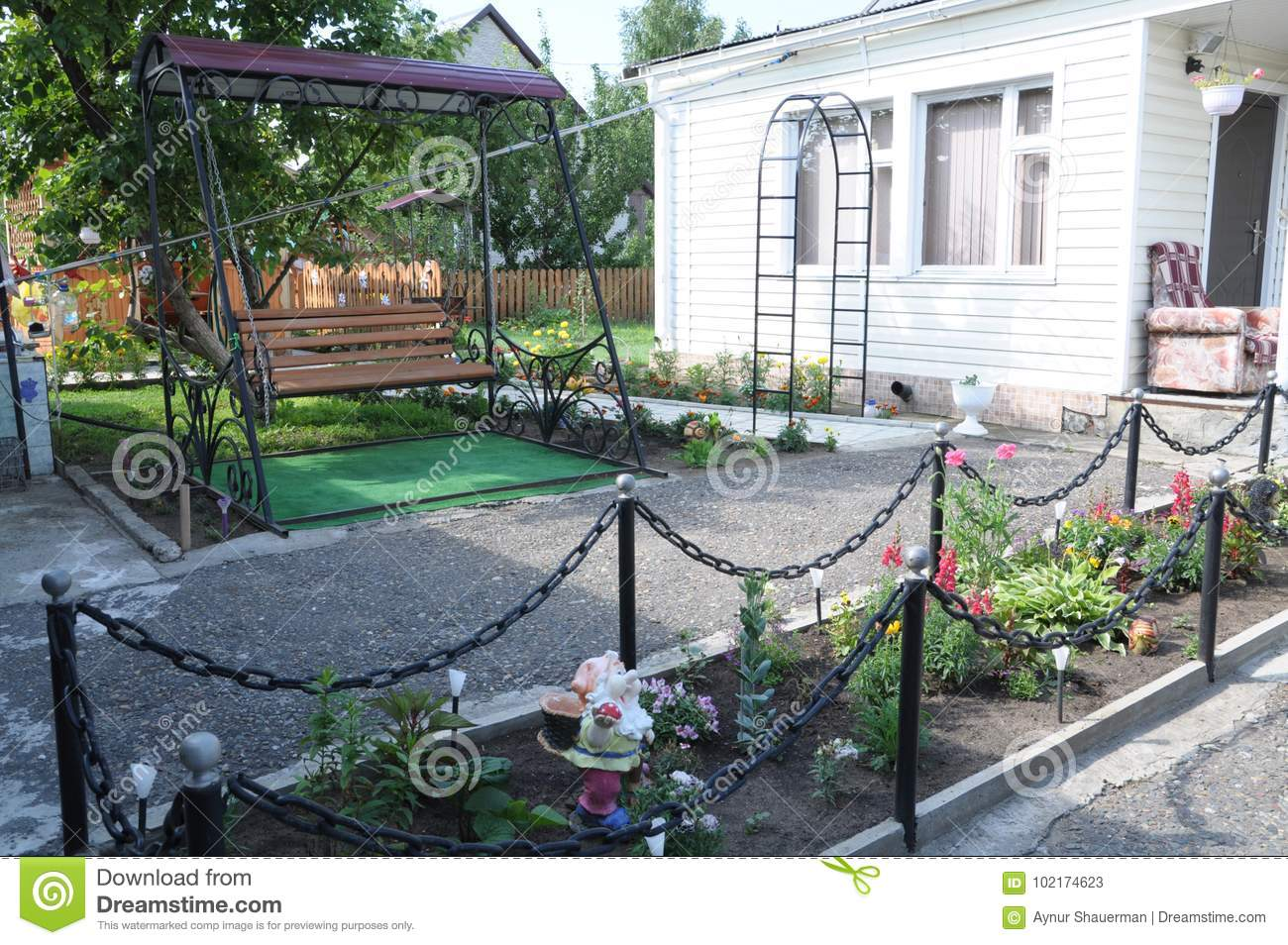 Resting Area With Swing In Garden Designing For Cottage Houses Stock