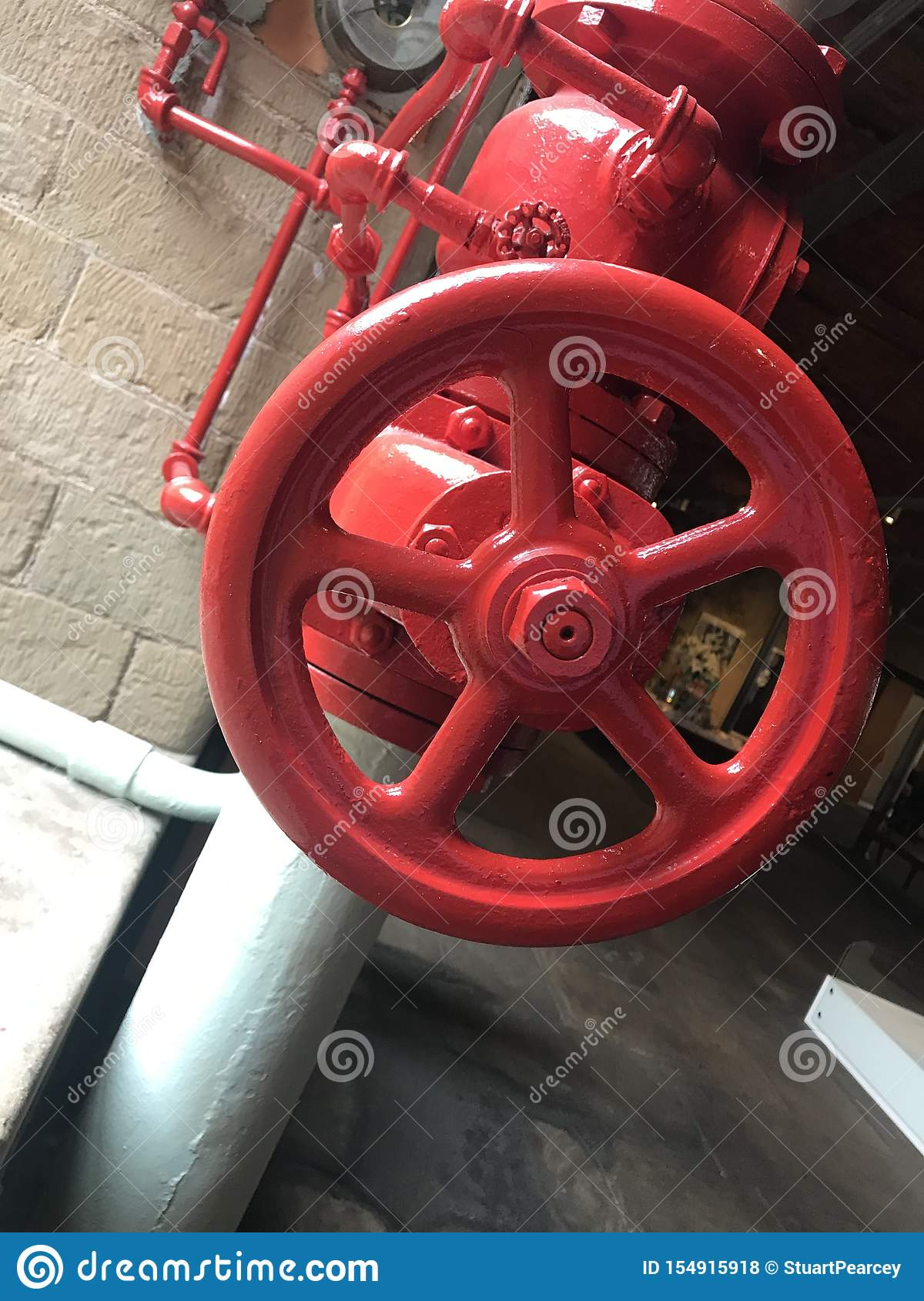 Restored red valve in Victorian factory