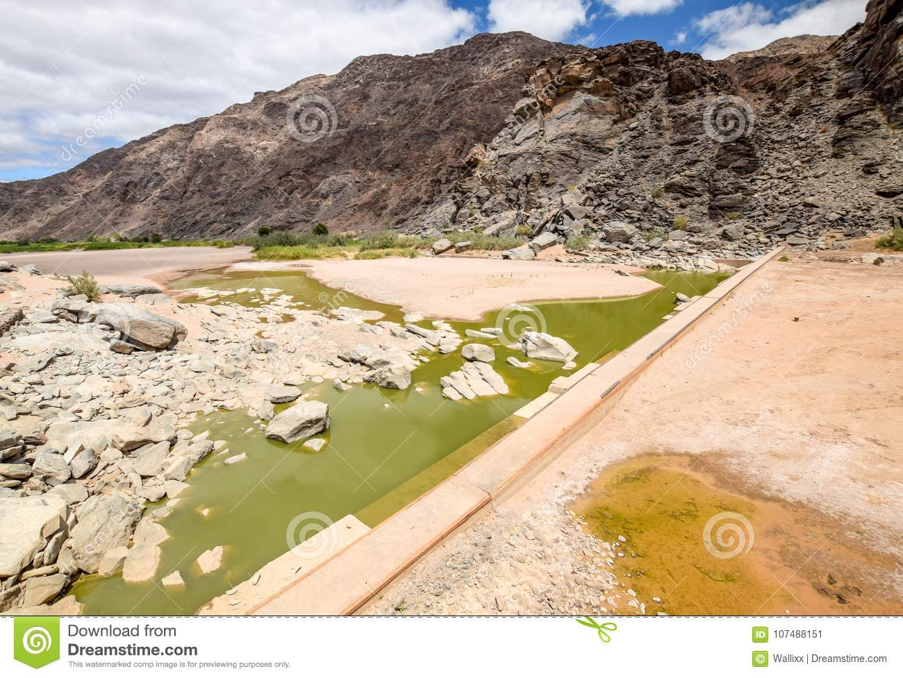 Rests of water and an old dam during dry season near Ai-Ais Hot Springs at Fish River Canyon, Namibia