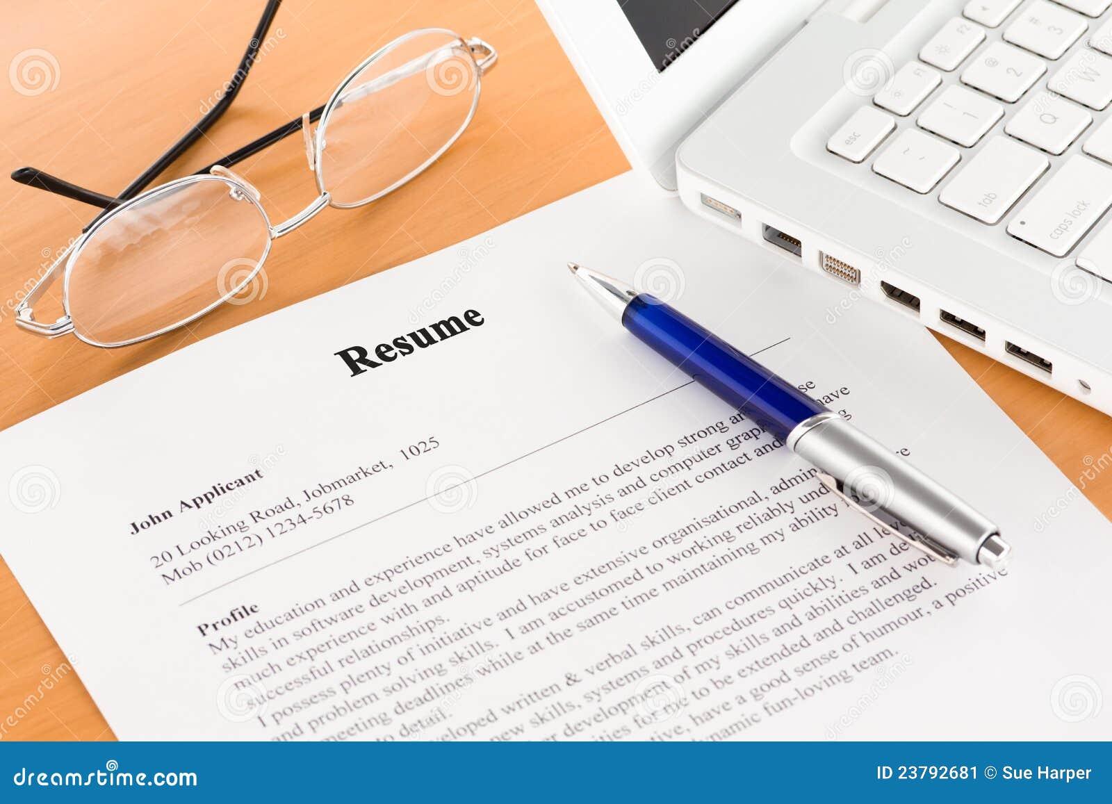 resume pen by laptop stock image image  resume pen by laptop