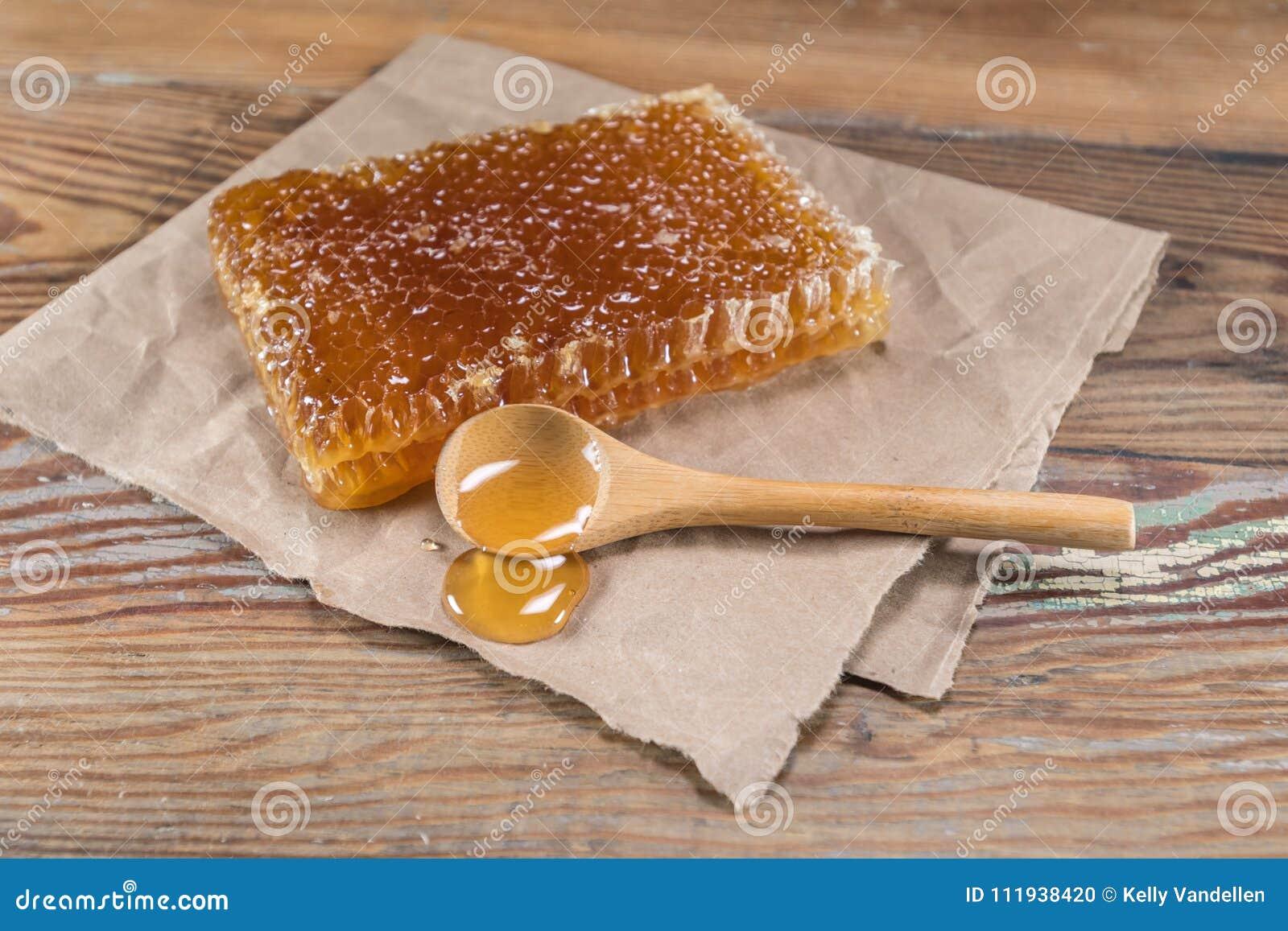 Retângulo Honey Comb e colher de madeira do mel