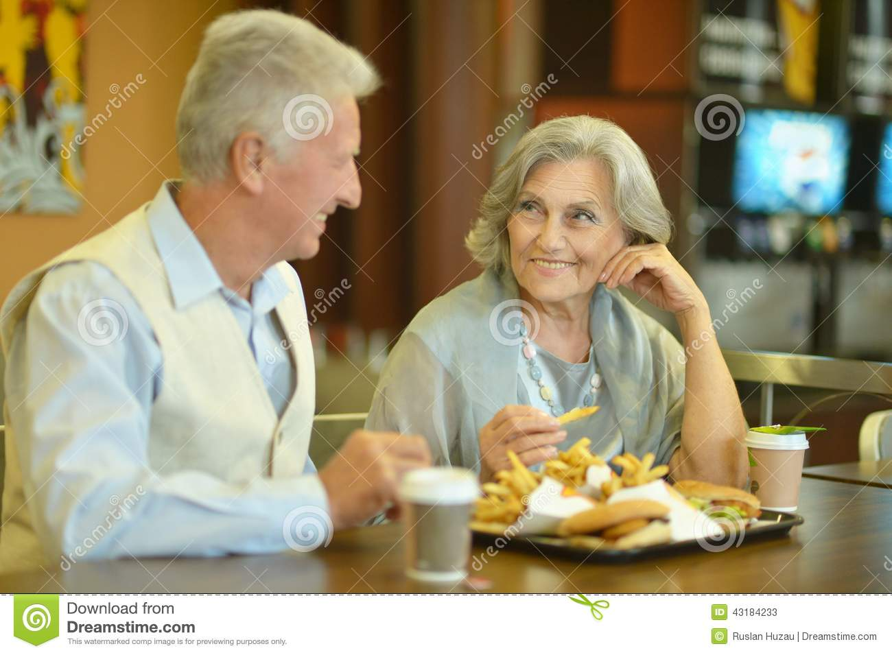 Retired Couple Eating French Fries