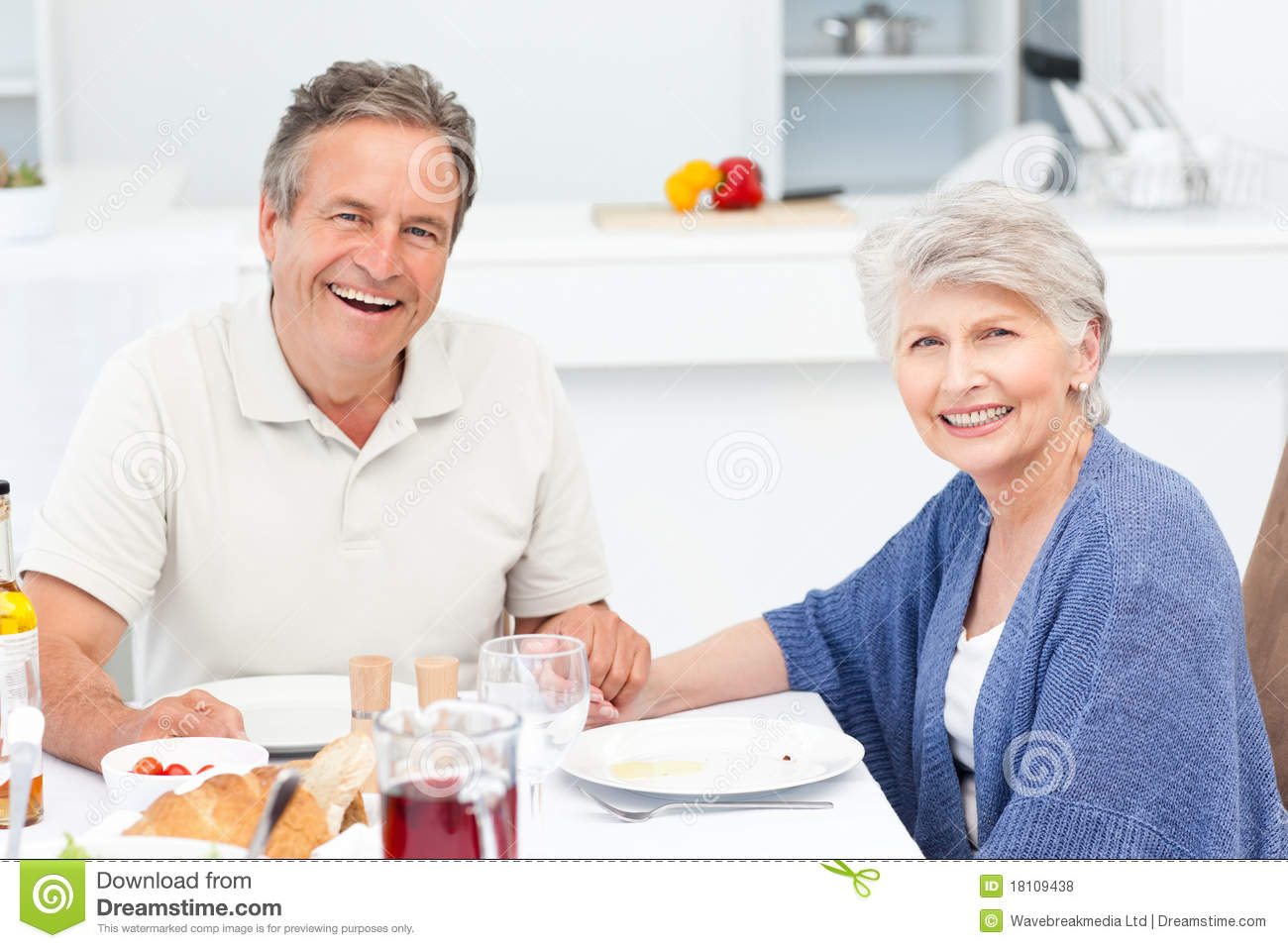 Retired Couple Eating In The Kitchen Royalty Free Stock