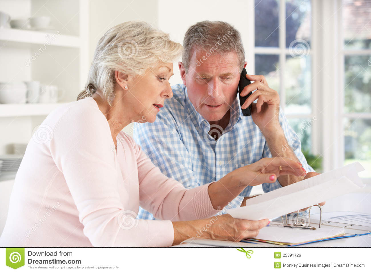 Retired couple with household bills royalty free stock for House plans for retired couples