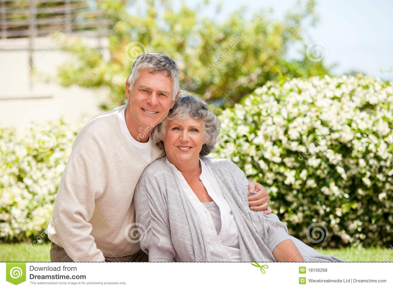 Retired couple looking at the camera royalty free stock for House plans for retired couples