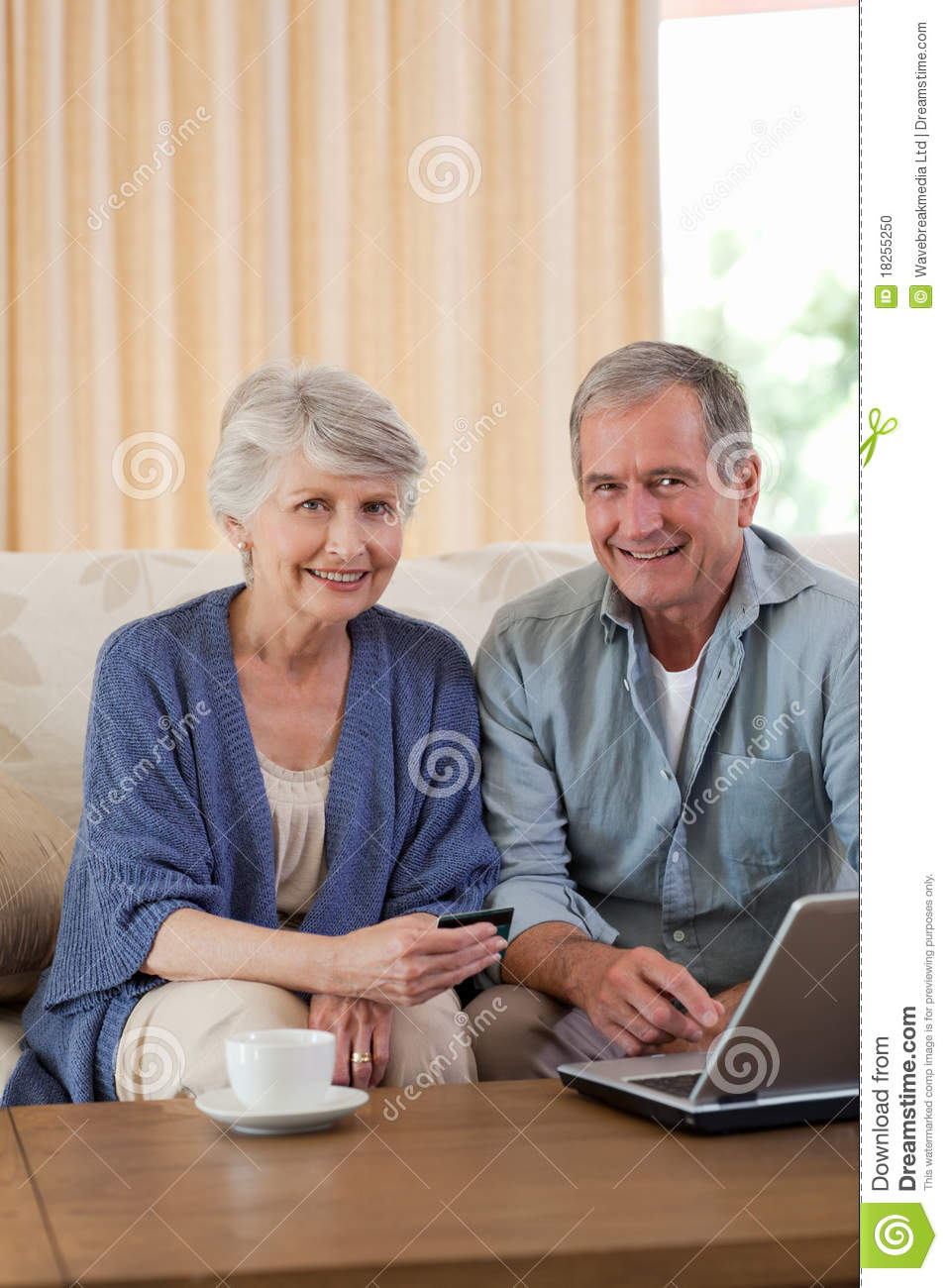 Retired couple looking at their laptop stock photo image for House plans for retired couples
