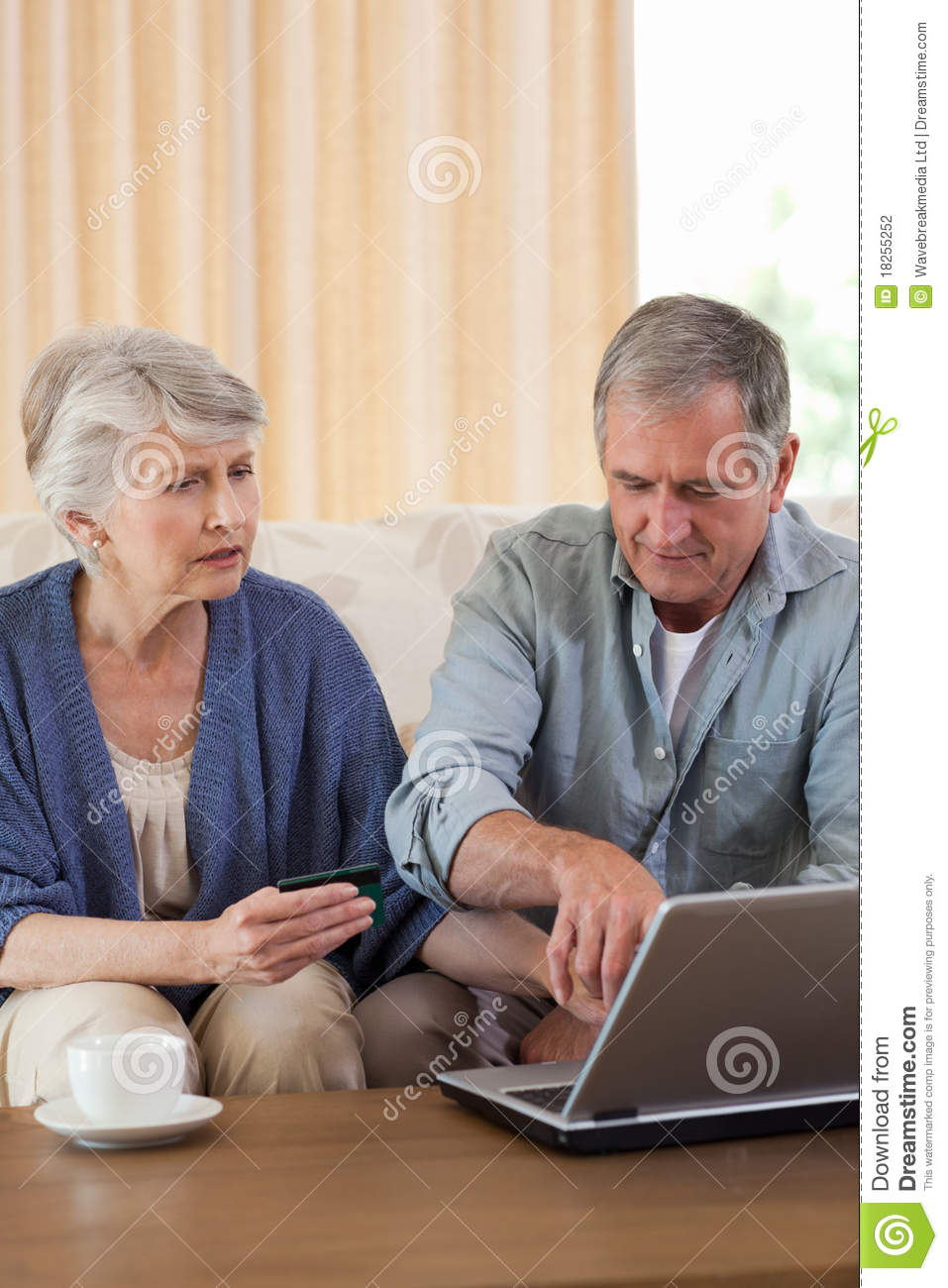 Retired couple looking at their laptop stock photography for House plans for retired couples