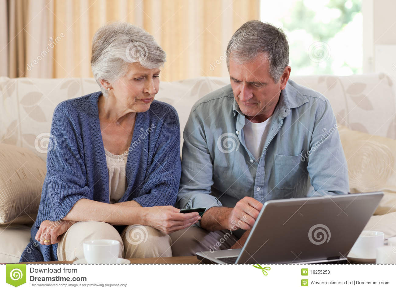 Retired couple looking at their laptop stock photos for House plans for retired couples