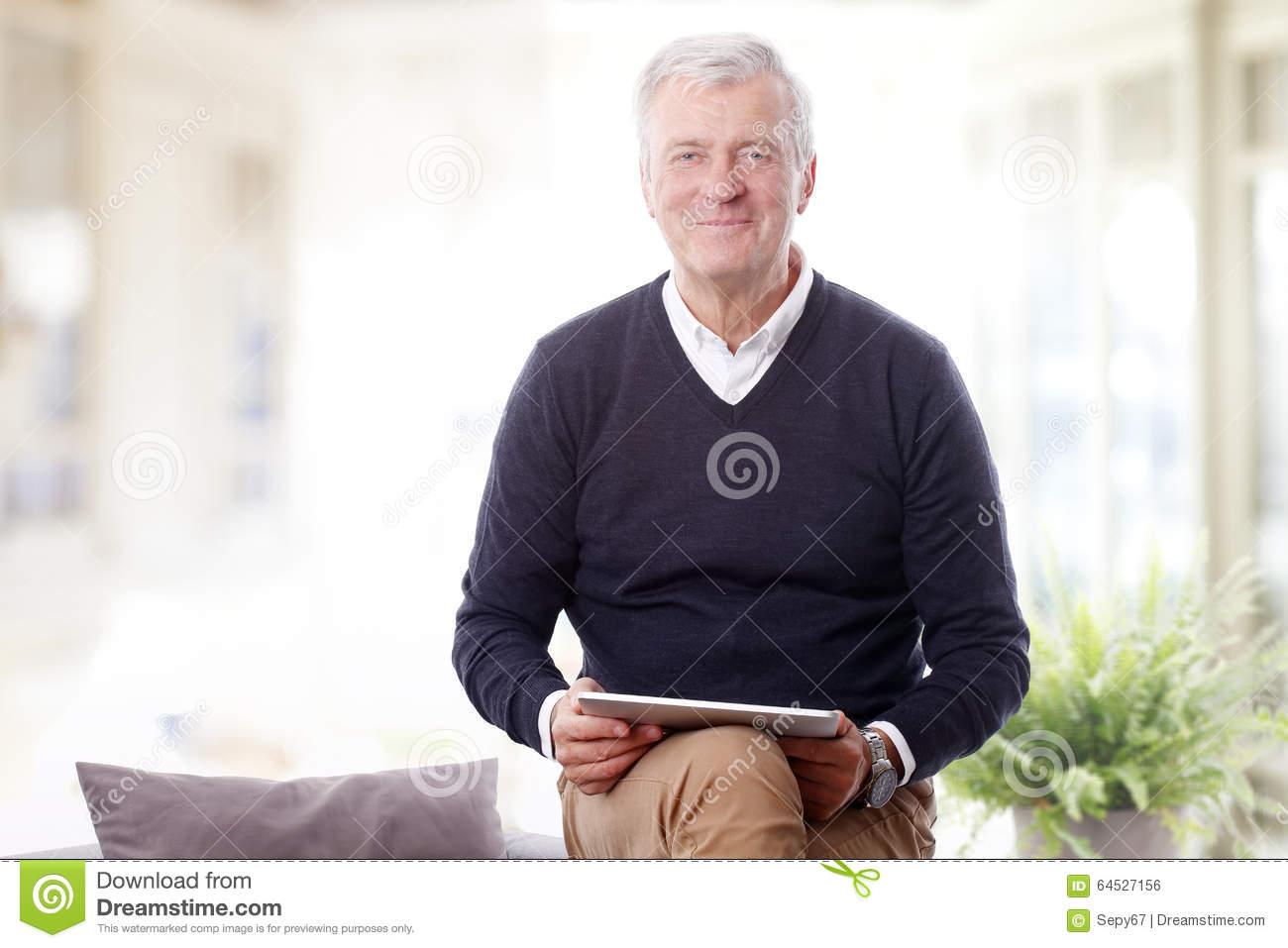 Retired man with digital tablet