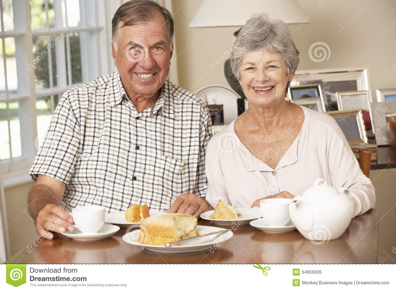 Retired senior couple enjoying afternoon tea together at for House plans for retired couples