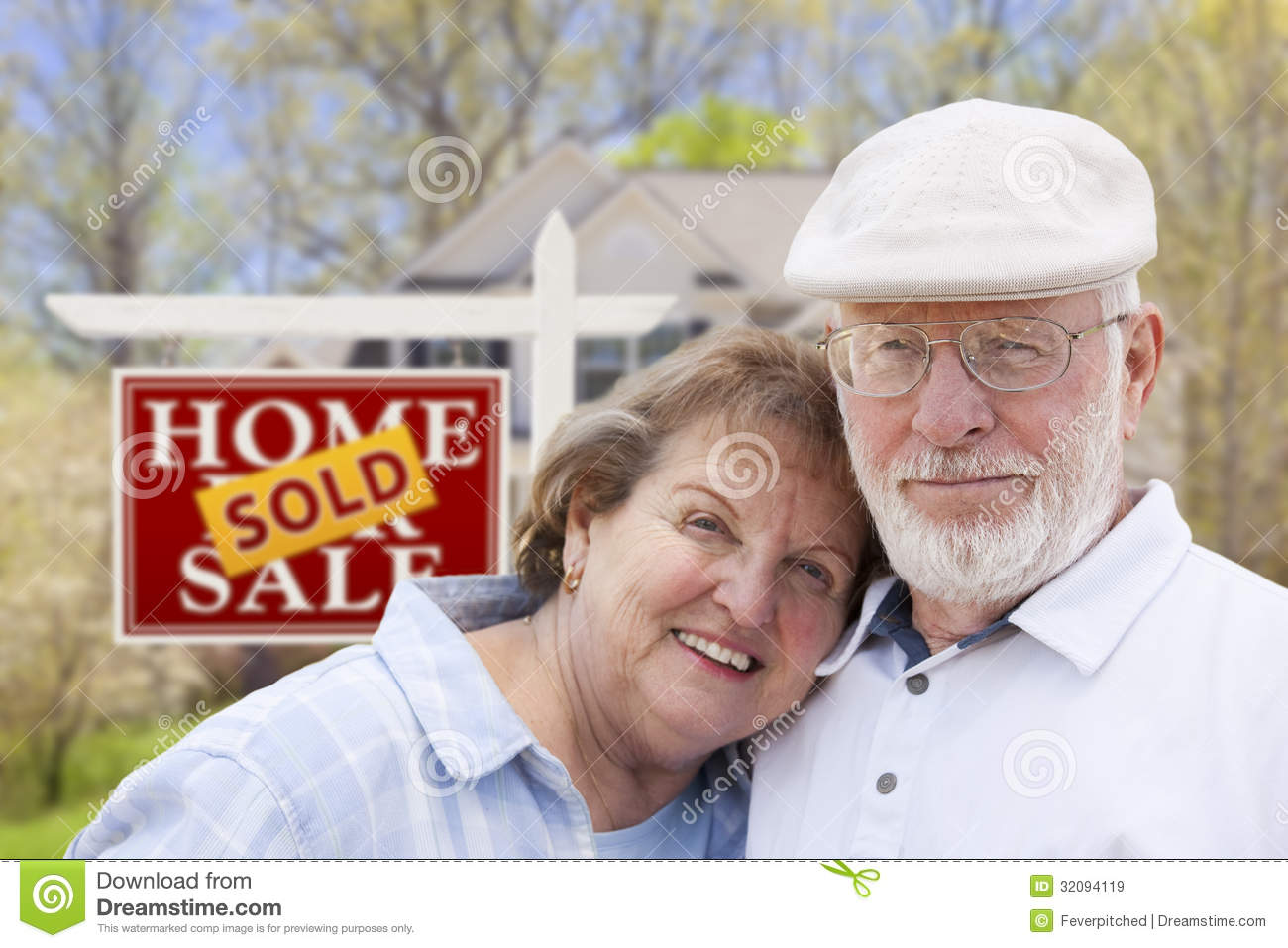 Retired Senior Couple In Front Of Sold Real Estate Royalty