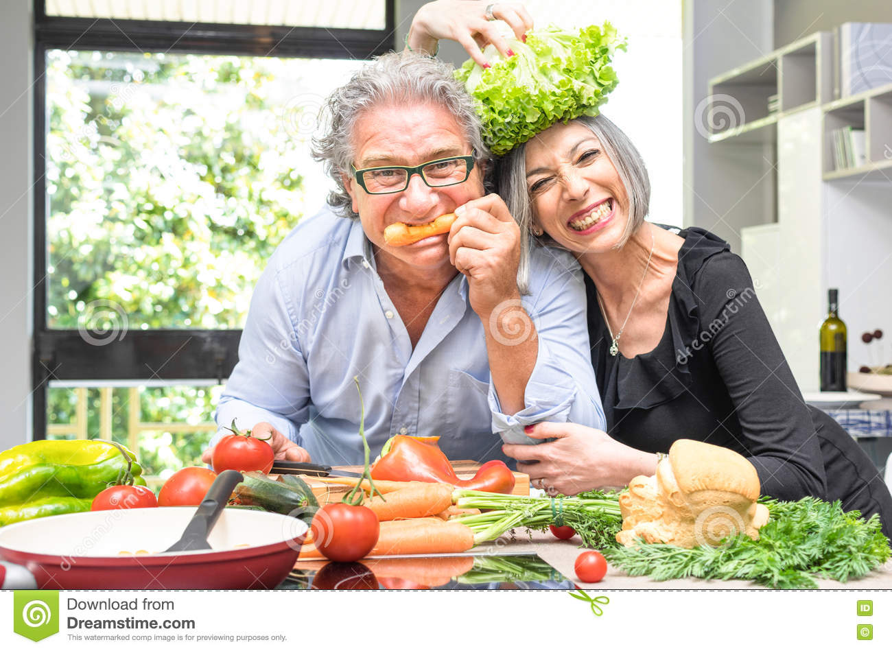 Happy Elderly Couple With Healthy Food