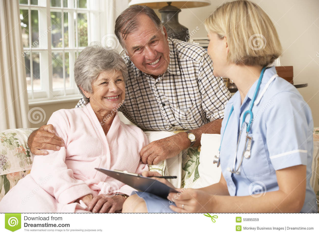 Retired Senior Woman Having Health Check With Nurse At Home