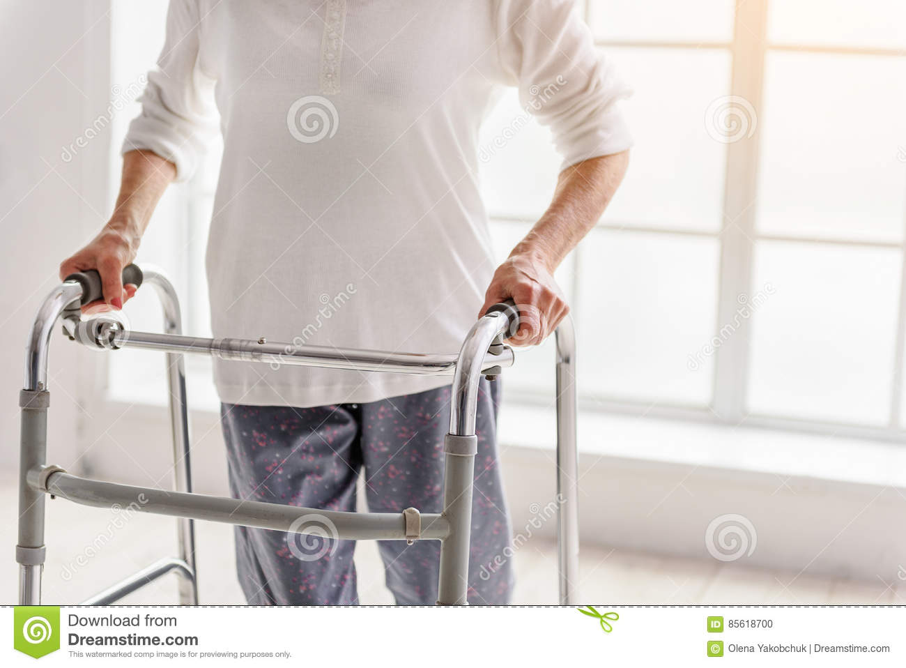 Retiree Keeping Walking Aid And Situating Near Time Bucket Stock ...