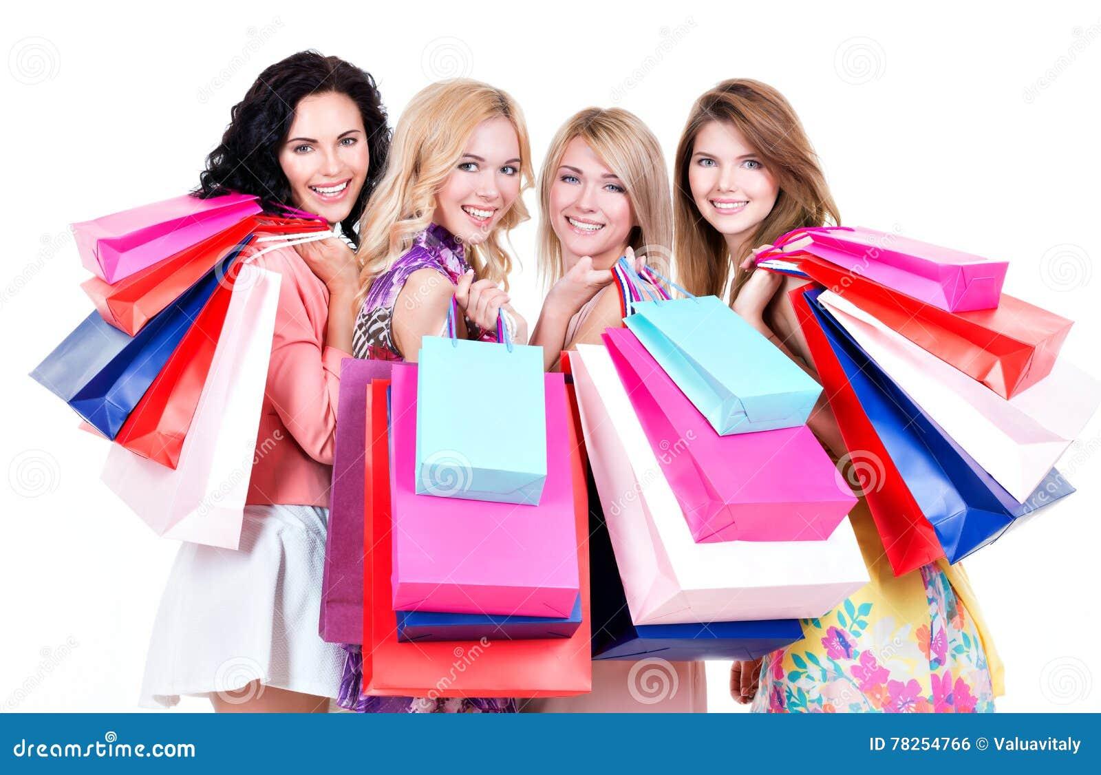 Retrato de comprar feliz bonito das mulheres