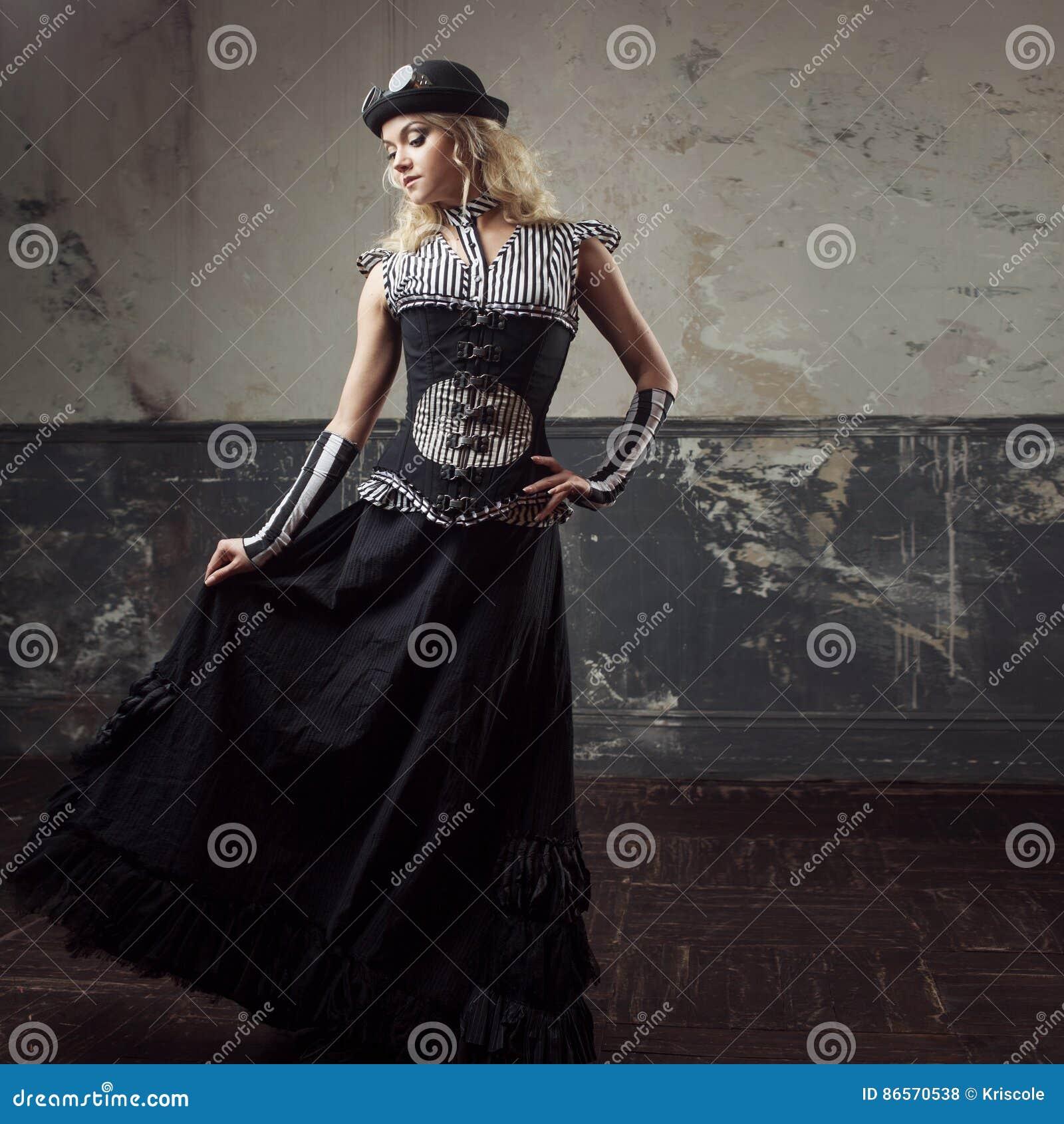 Retrato de una mujer del steampunk sobre fondo del grunge Señora hermosa en  un estilo victoriano 219ae56f5c5