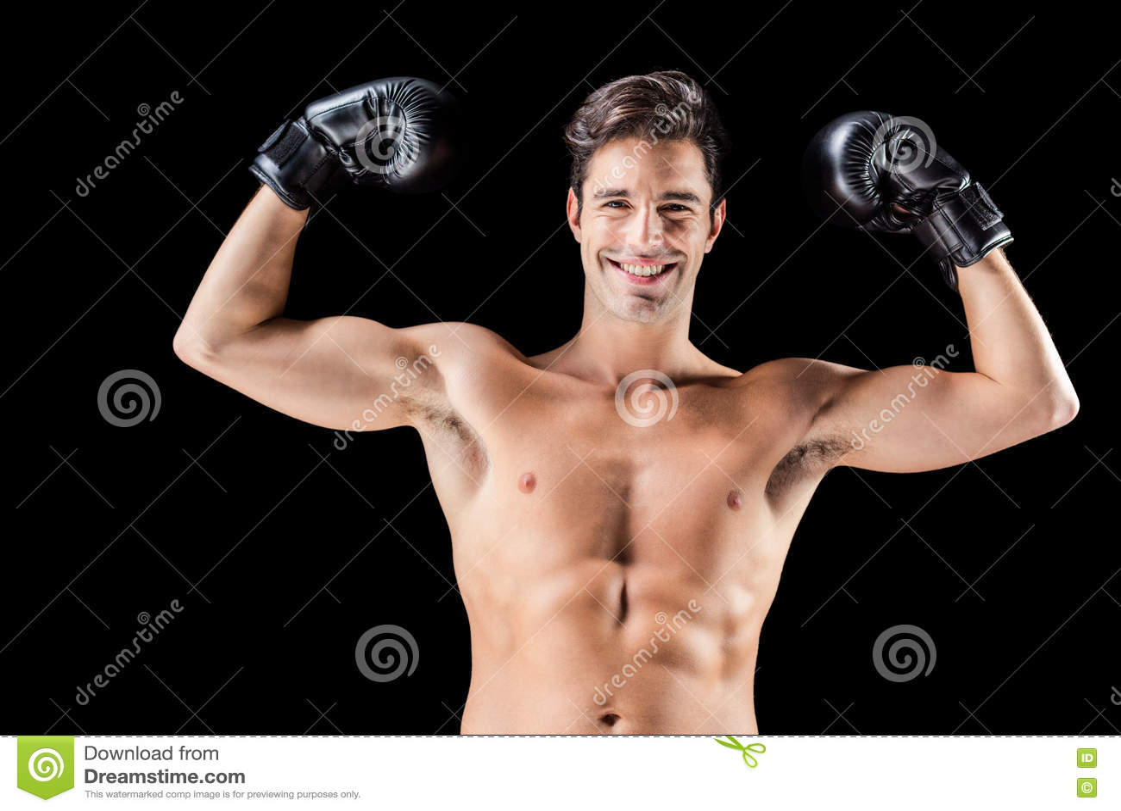 Retrato Del Boxeador Feliz Que Muestra Los Músculos Foto de archivo