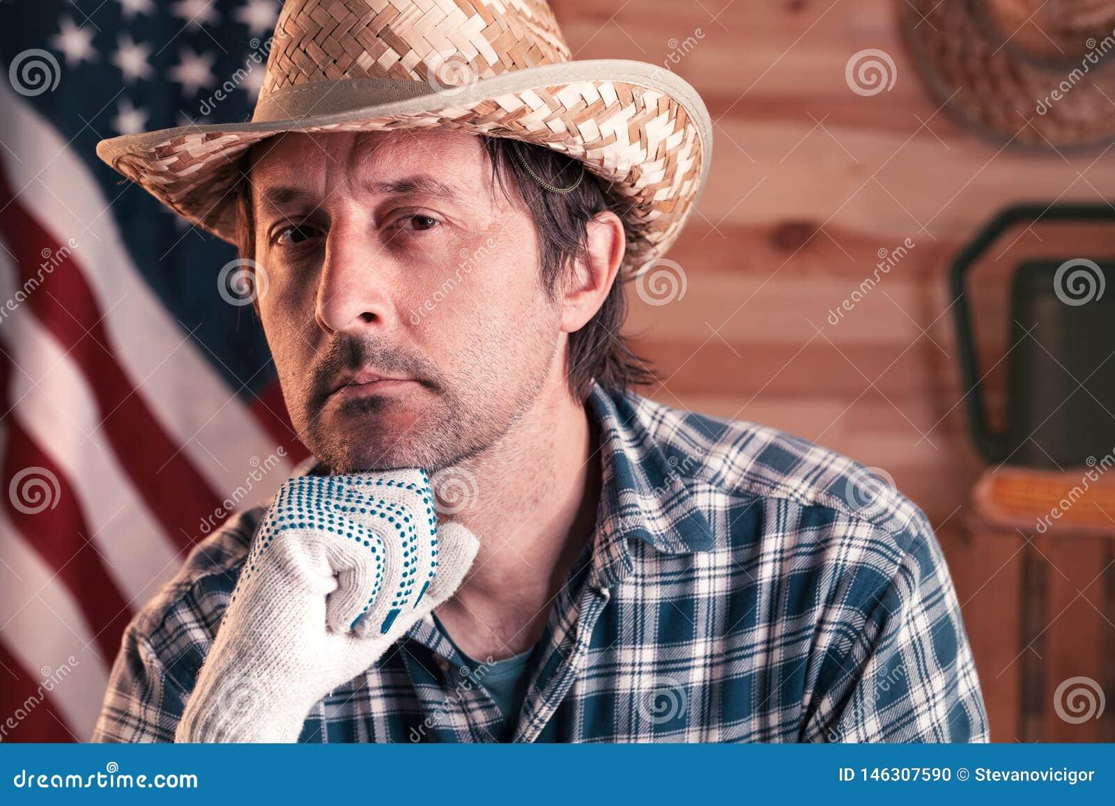 Retrato del granjero de sexo masculino americano confiado