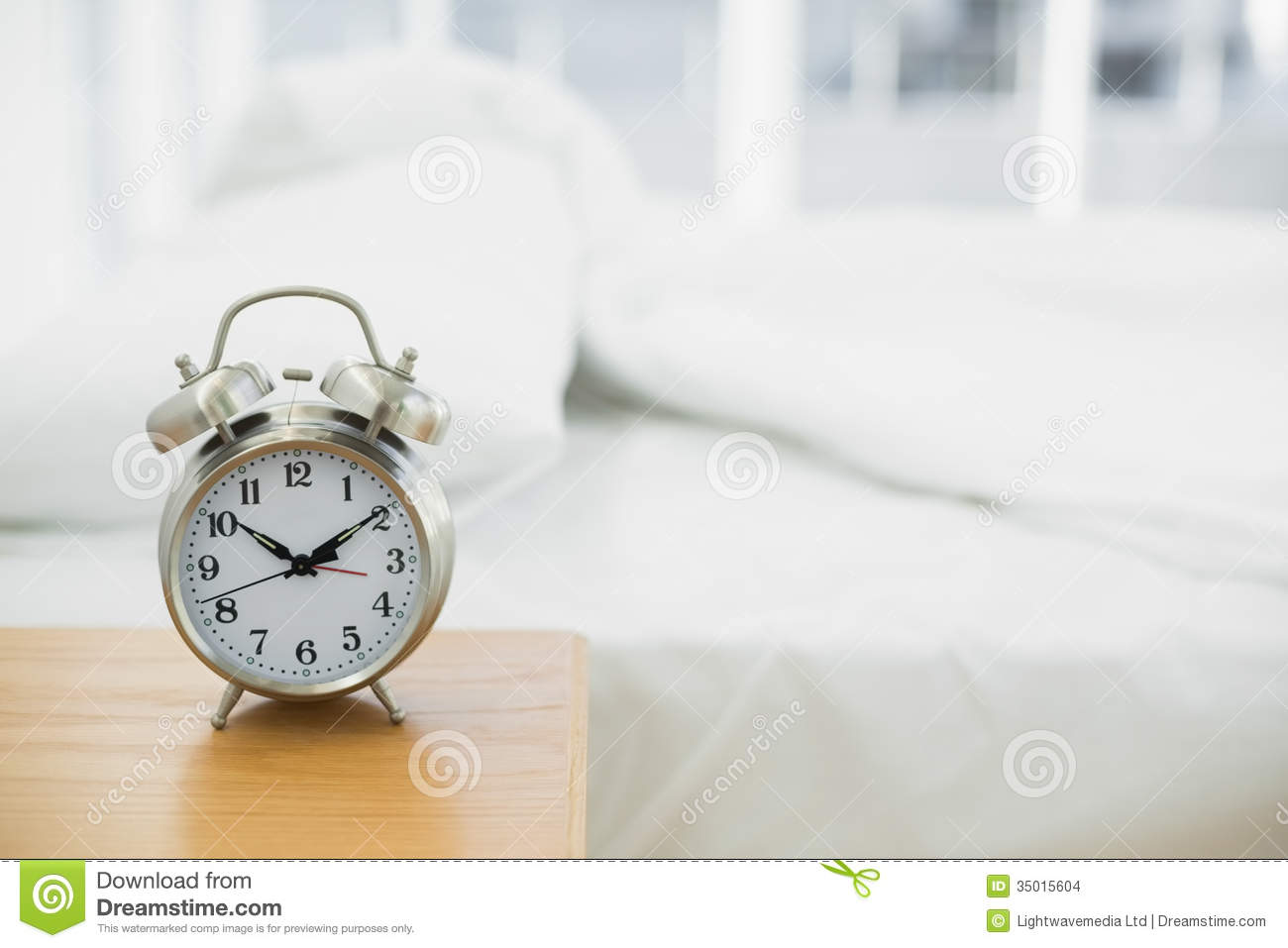 Retro Alarm Clock Standing On A Bedside Table Stock Photo ...