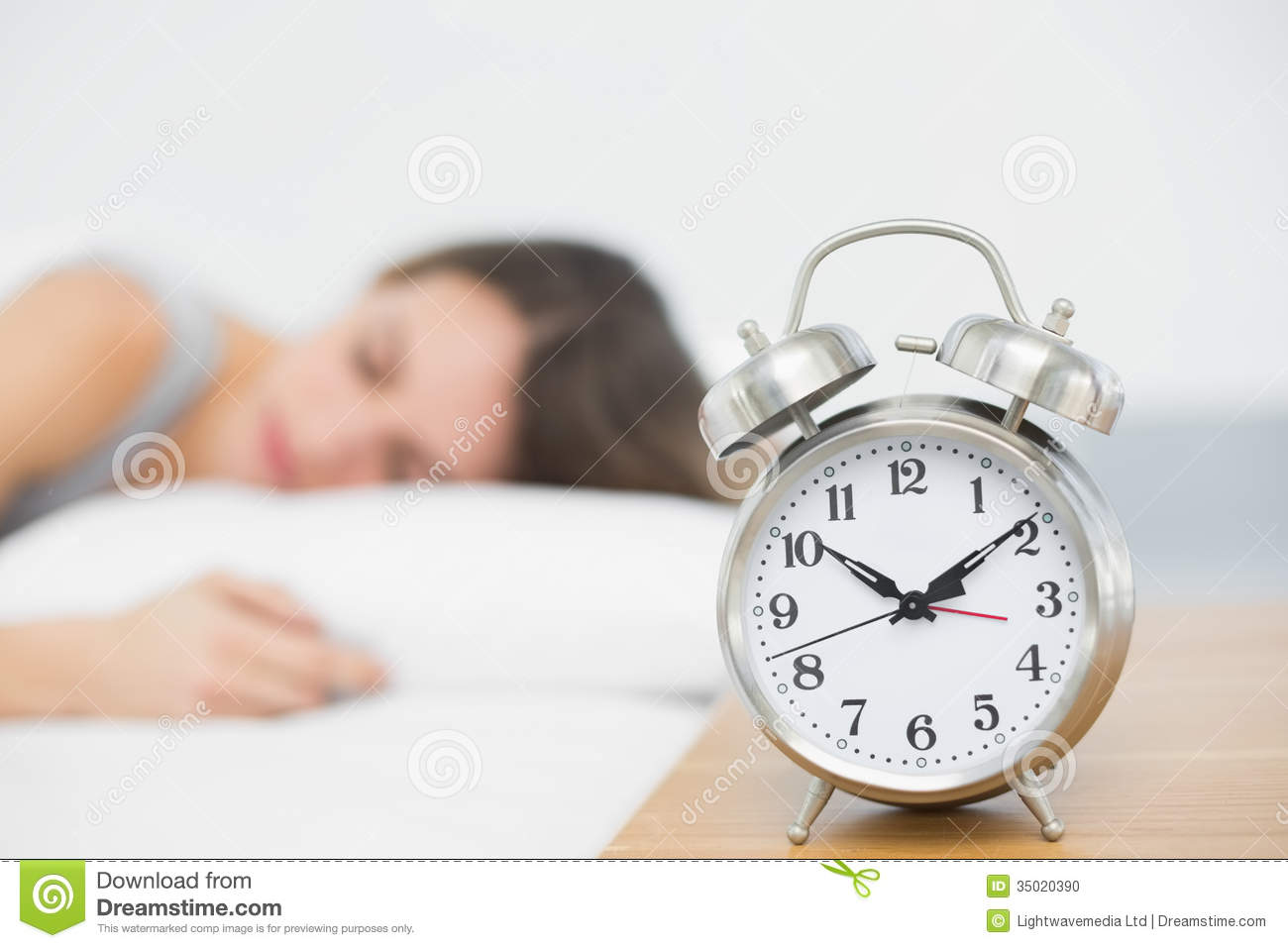 Retro Alarm Clock Standing On Bedside Table Stock Photo