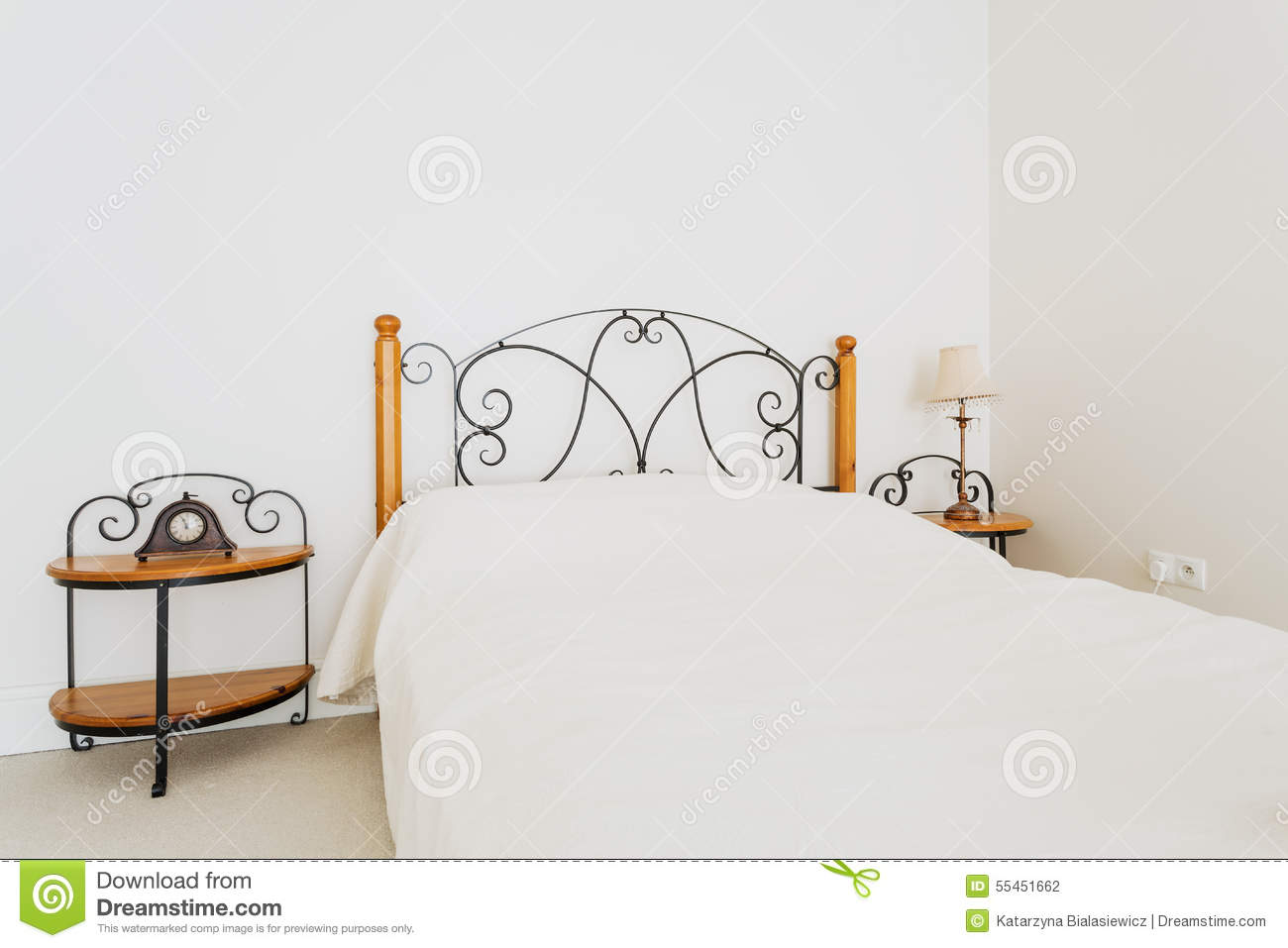 Close Up Of Luxury Bed And Bedside Table With Lamp Royalty