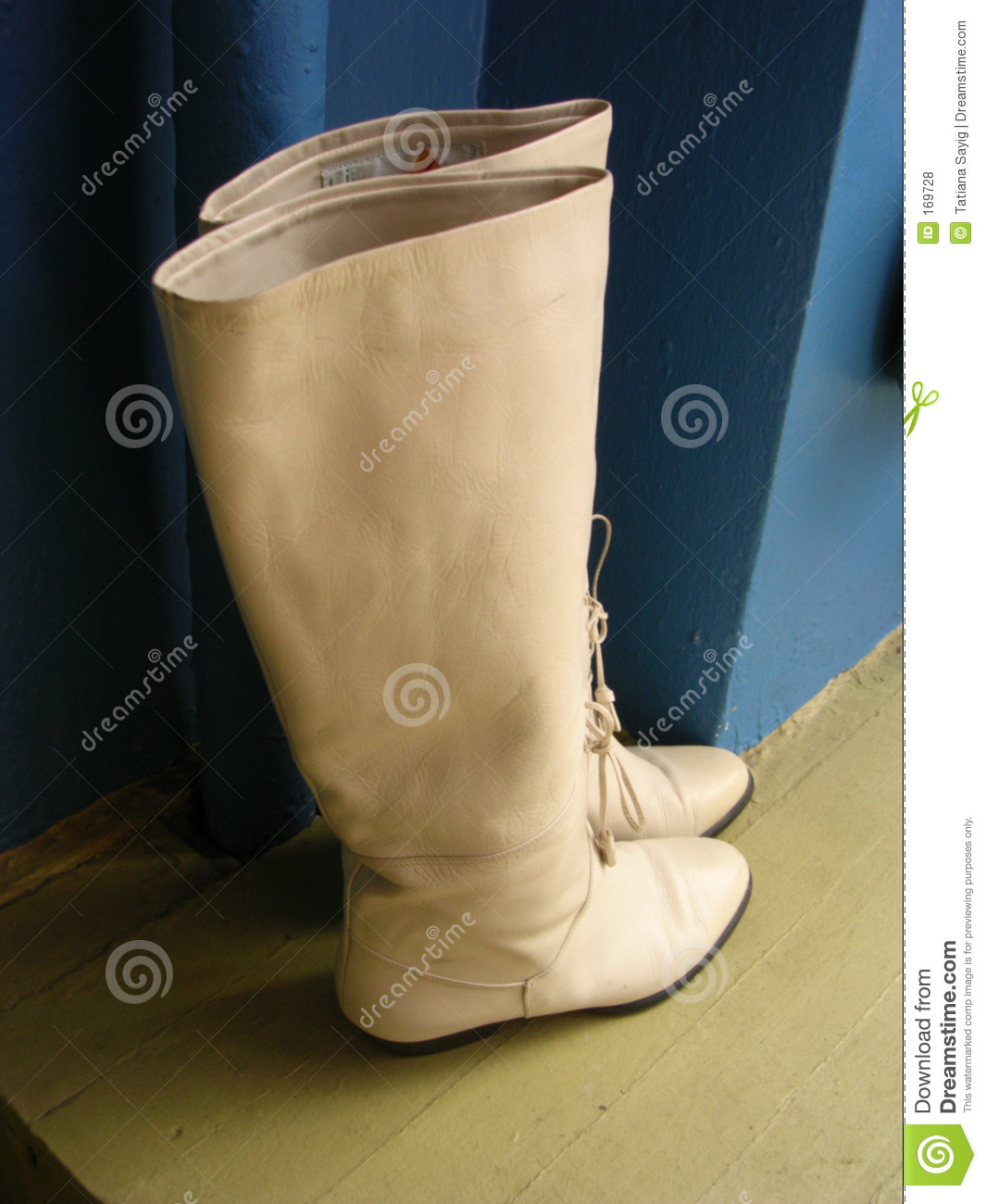 Retro Beige Boots Against Blue Wall