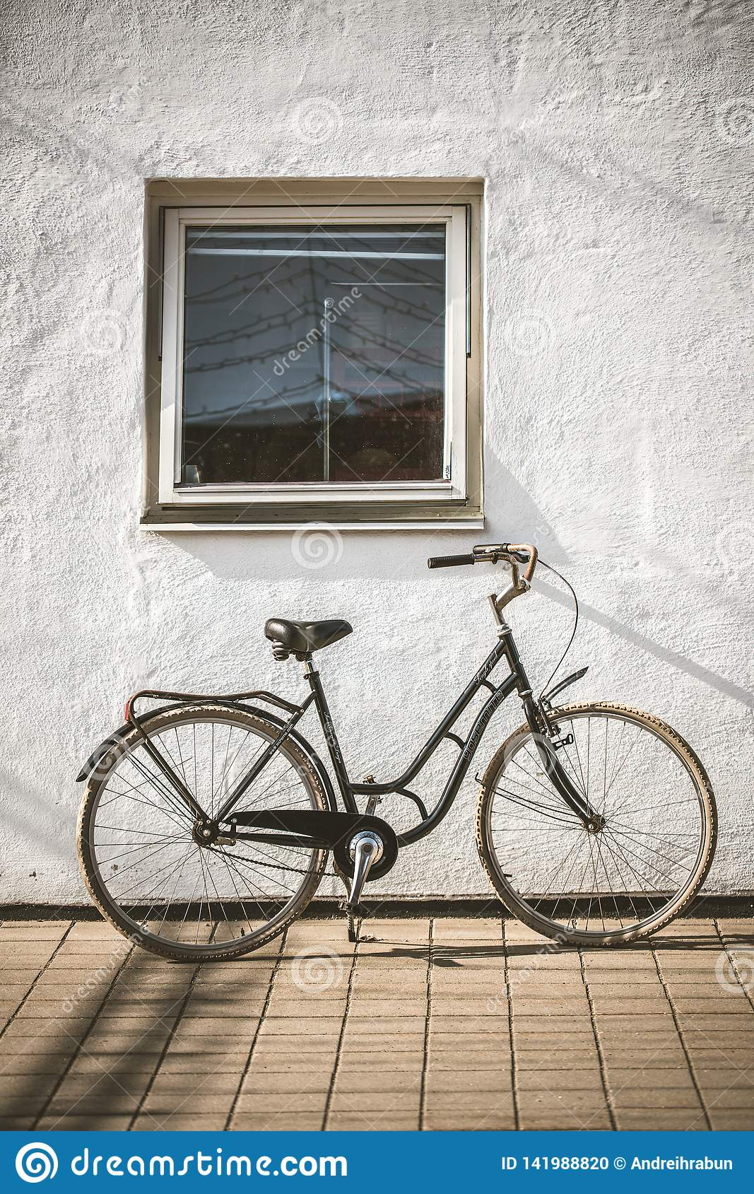 Retro Bicycle On Roadside With Vintage Concrete Wall