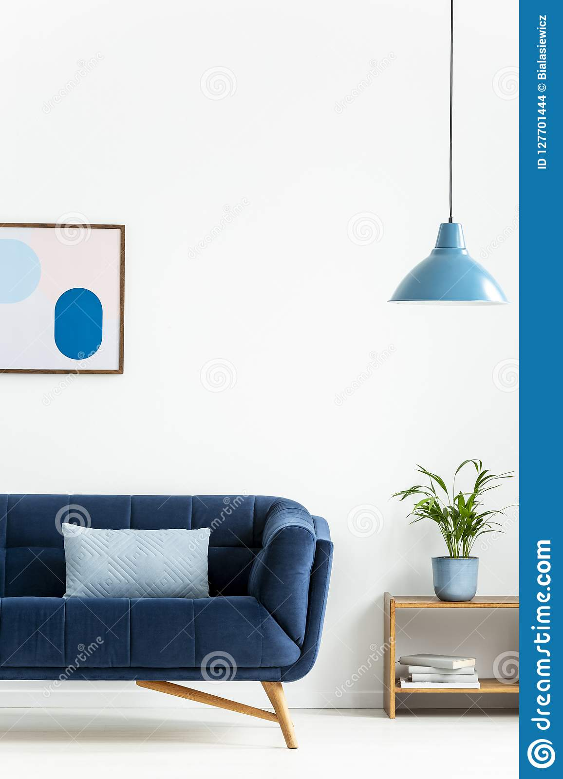 Retro Bowl Pendant Light And A Baby Blue Cushion On A Dark Elegant Sofa In A Simple Living Room Interior With White Walls Real P Stock Photo Image Of Side Pillow