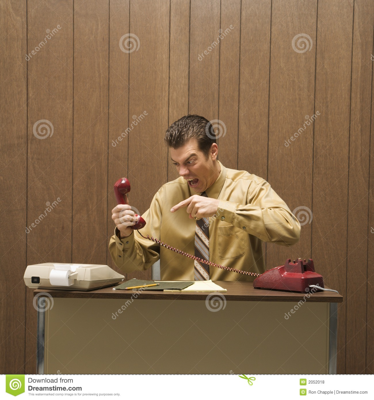 Retro Business Scene Of Angry Man At Desk Royalty Free