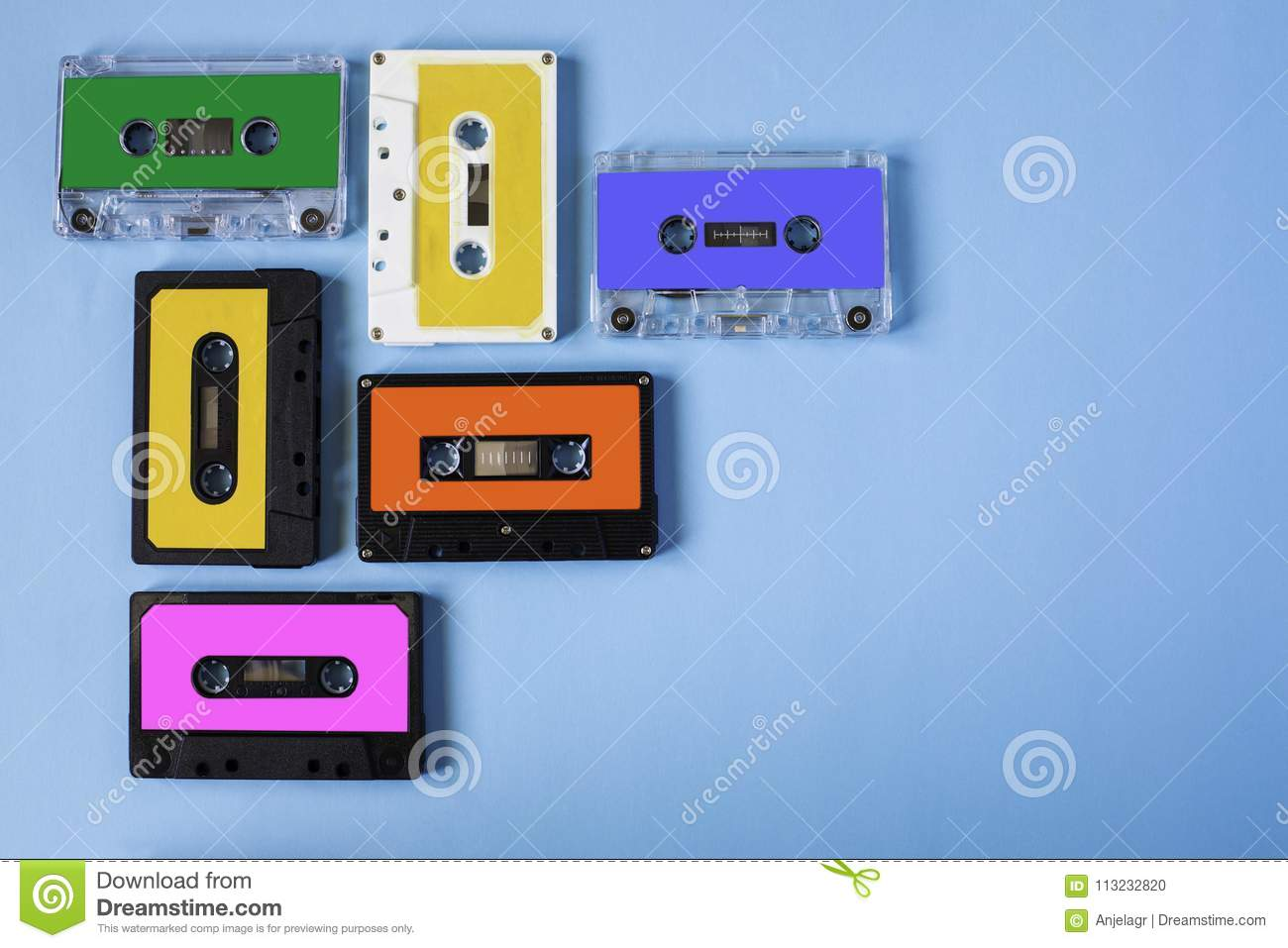 Retro cassette tape collection on blue background.