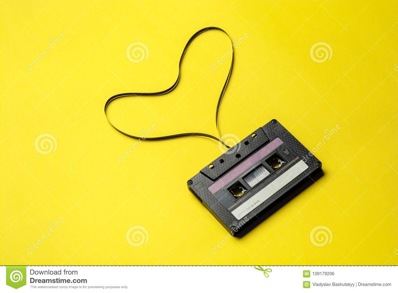 Retro Cassette Tape Over Yellow Background Top View Copy Space