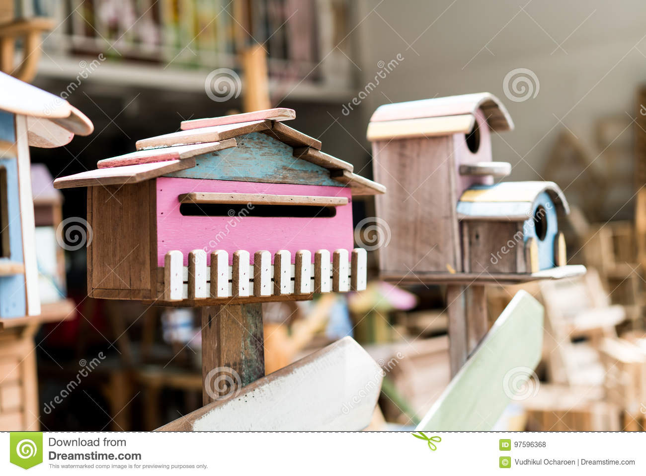 Retro Colorful Bird House In Vintage Store Stock Photo