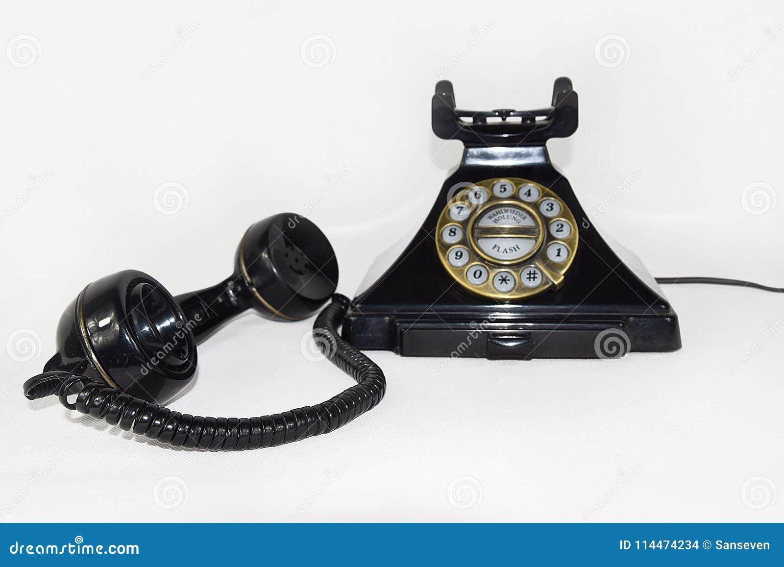 Retro czerń telefon, earpiece podnosił up i kłaść na boku - Odosobnionego
