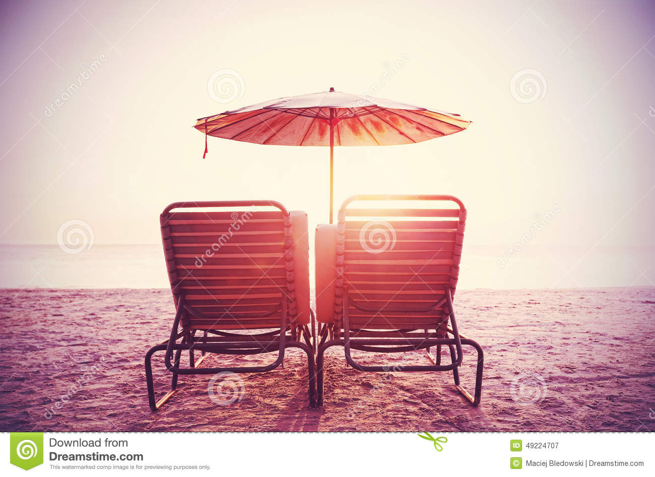 Retro Filtered Picture Of Beach Chairs And Umbrella On