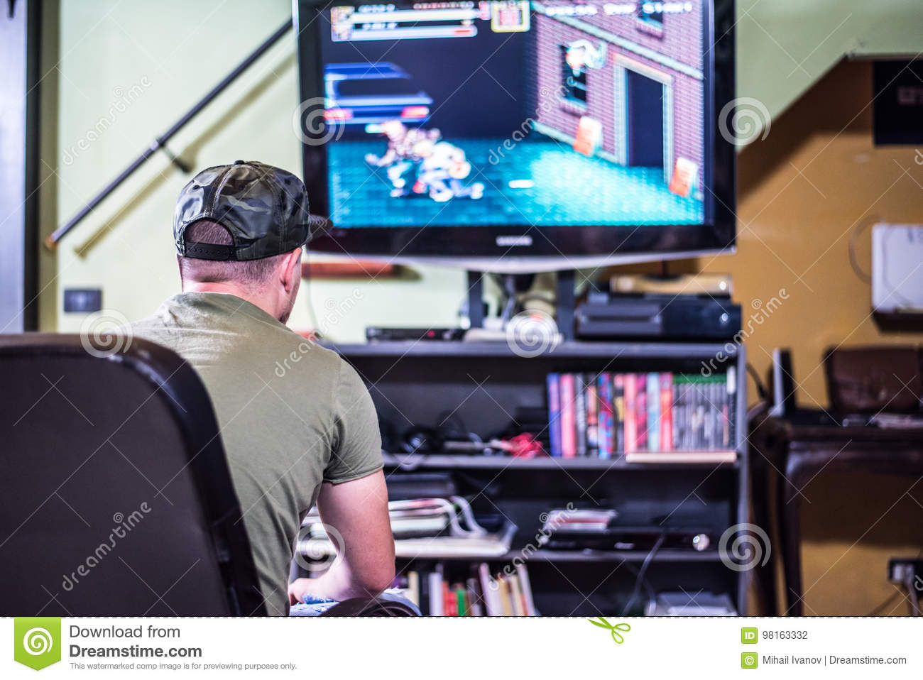 Retro Gamer In Front Of The TV Stock Photo - Image of adult, front